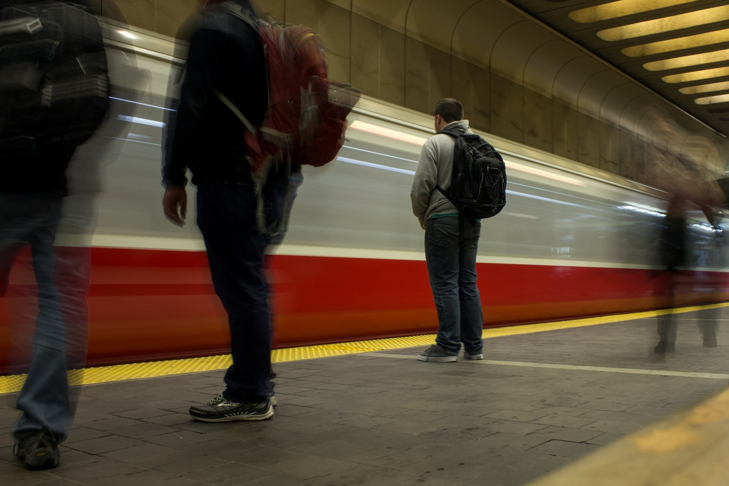 Passengers line up outside an arriving MBTA subway car, preparing to board during rush hour traffic on a Thursday evening.  From next year, undergraduate HUIDs for new students will add MBTA CharlieCard functionality.