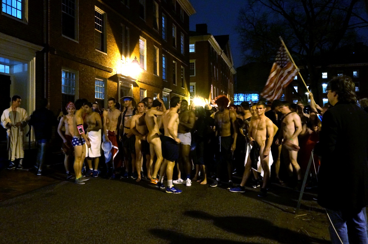 Students gather in Harvard Yard at midnight before finals period to relieve stress through a spring Primal Scream.