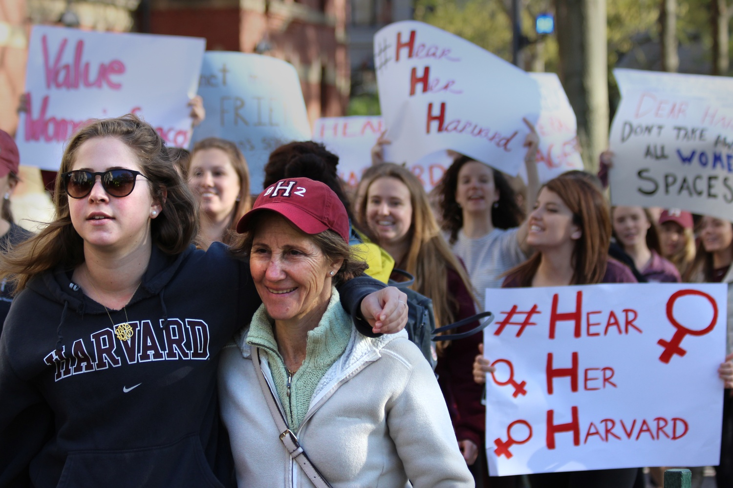 Kappa Kappa Gamma sorority member Elly Duker '19 marched with her mother, Julie Starr-Duker '82, at the #HearHerHarvard protest against newly-announced sanctions against unrecognized single-gender social organizations. More than 200 women rallied in front of Massachusetts Hall in response to the policy, which will bar members of such organizations from holding leadership positions in official clubs and receiving top fellowships.