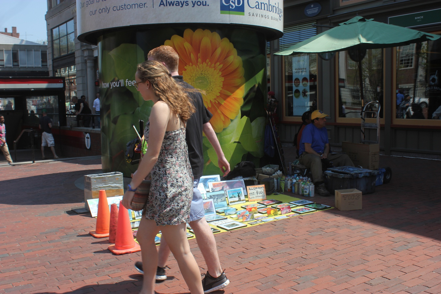 Visitors to Harvard Square start showing up in summer clothing as the weather warms.
