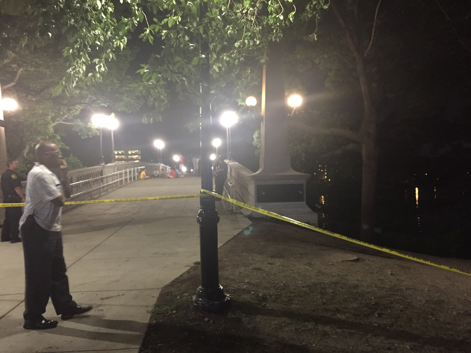 Police stood near Weeks Footbridge. A person was recovered from the Charles Friday night.