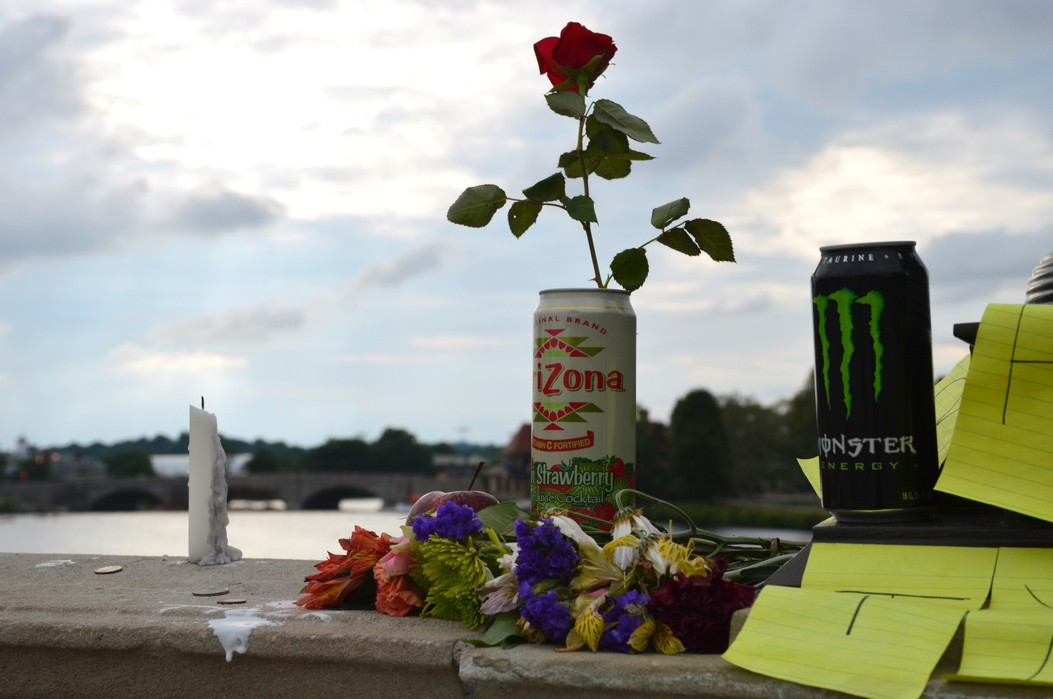 Students left notes, candles, flowers, red apples and several cans of kiwi-strawberry Arizona iced tea on Weeks Footbridge in memory of Tyler S. Greene, who drowned Friday night. The iced tea was, according to a fellow student who wished to remain anonymous, Greene's favorite drink.