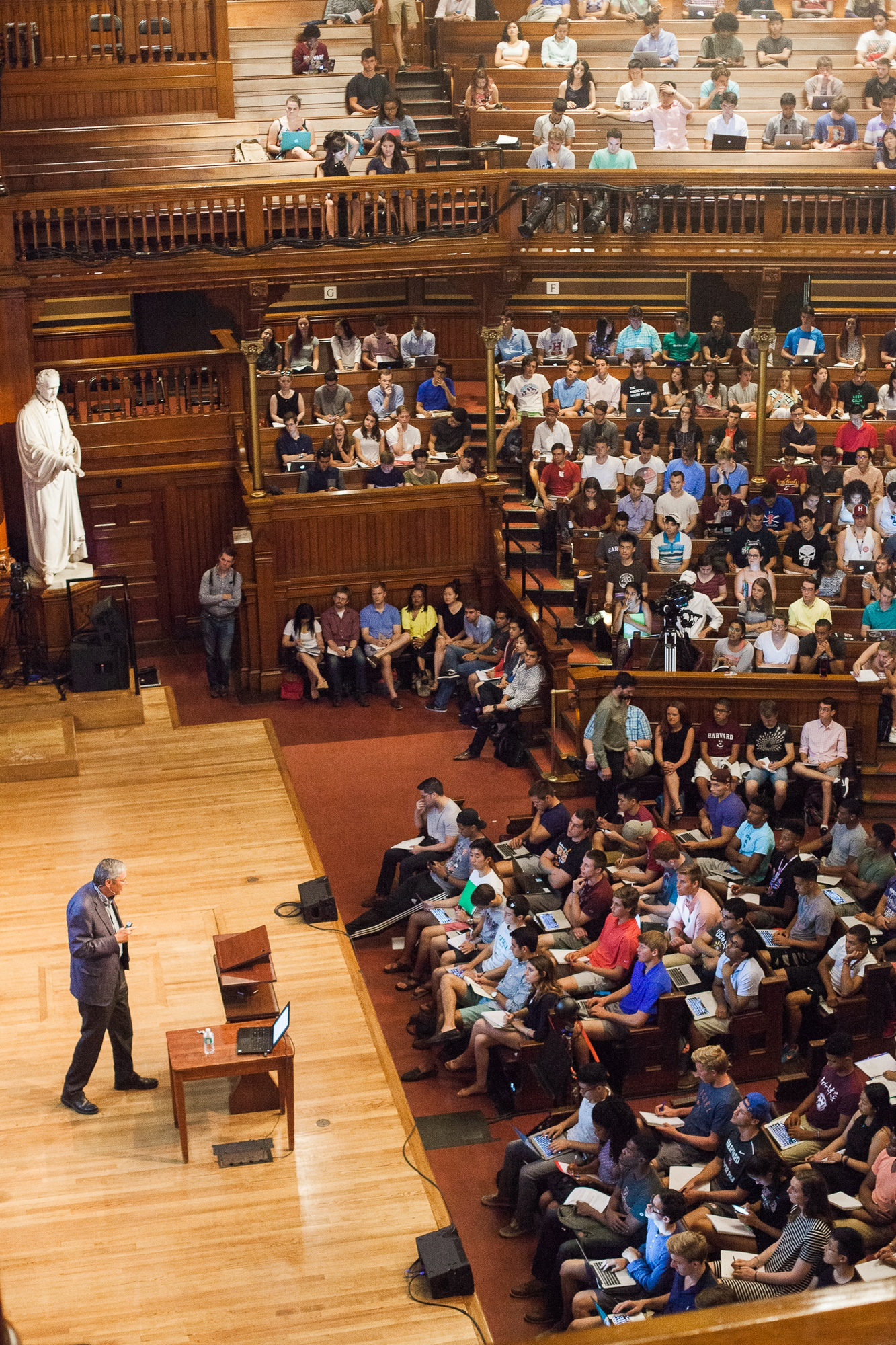 """Students shop Economics 10a: """"Principles of Economics,"""" a perennial favorite, which meets in Sanders Theatre on Wednesday at noon."""