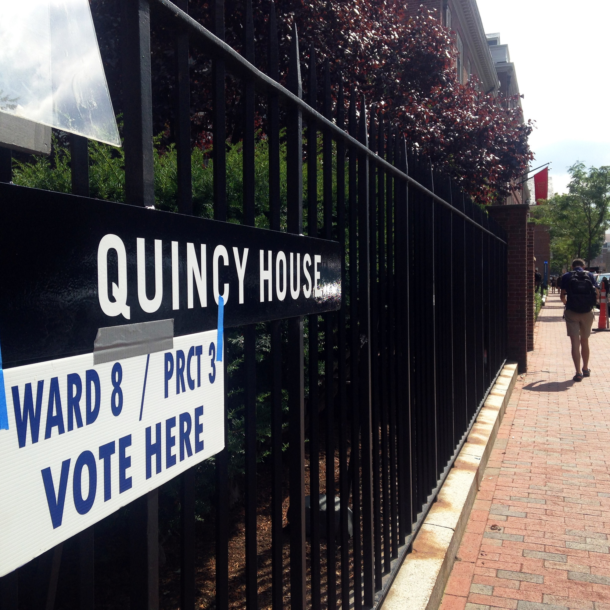 A student walks past the polling place set up in Quincy House for the Massachusetts Primary.