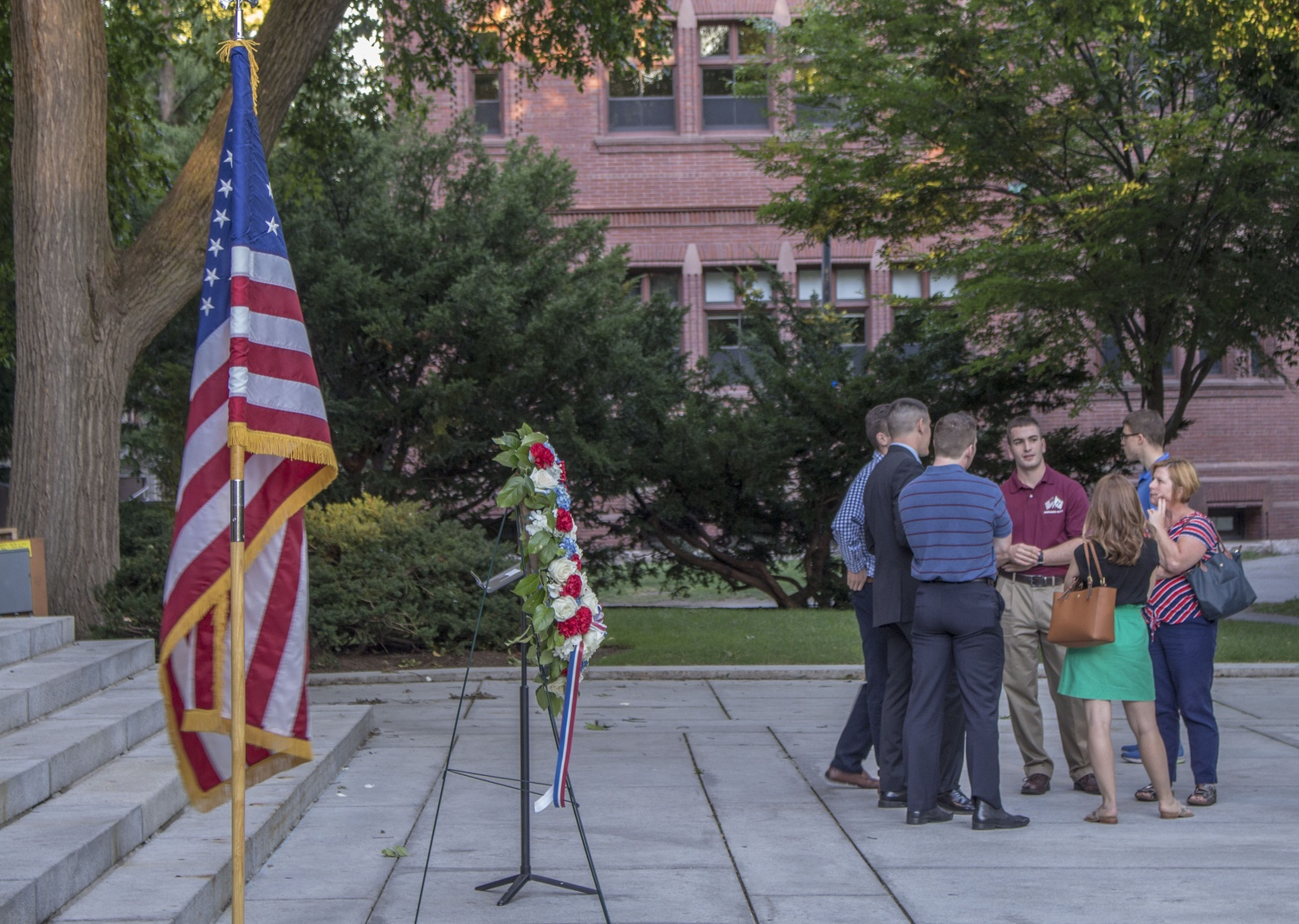 Harvard ROTC members and their families, along with students and faculty, gather for a 9/11 memorial at the Memorial Church steps Sunday evening. The event, which featured a speech by Dean of the College Rakesh Khurana and a wreath laying ceremony by Harvard ROTC, was in remembrance of the 15th anniversary.