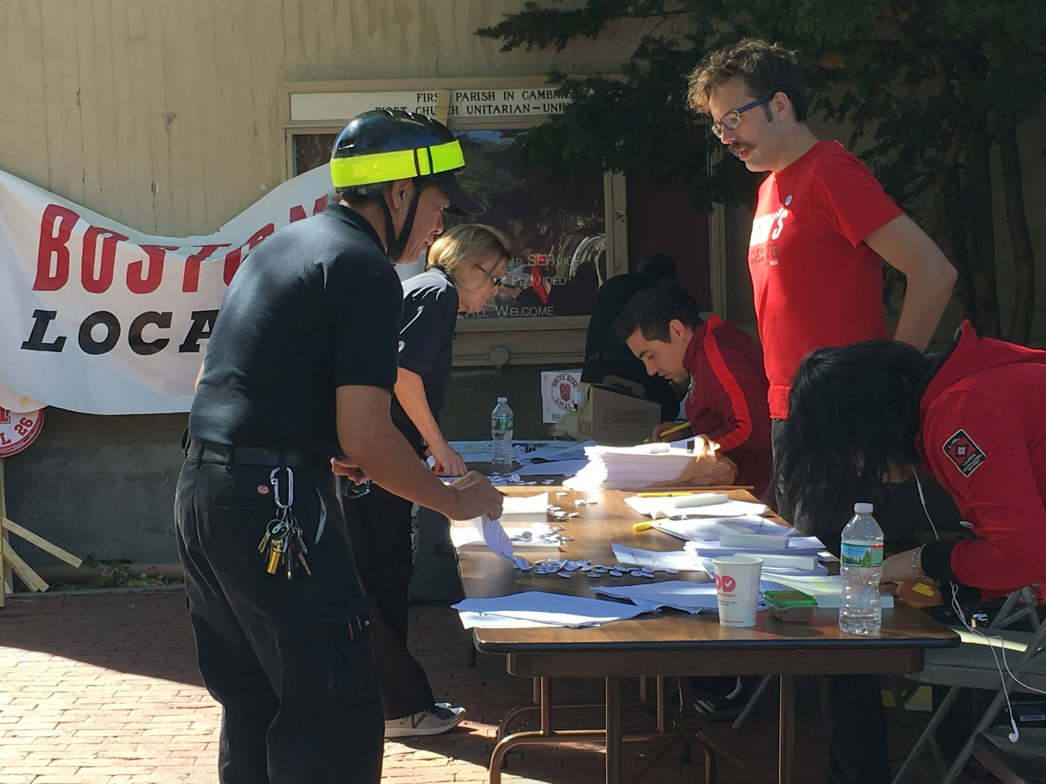Workers cast their ballots at the HUDS Strike Vote outside First Parish Church in Cambridge on Thursday afternoon.