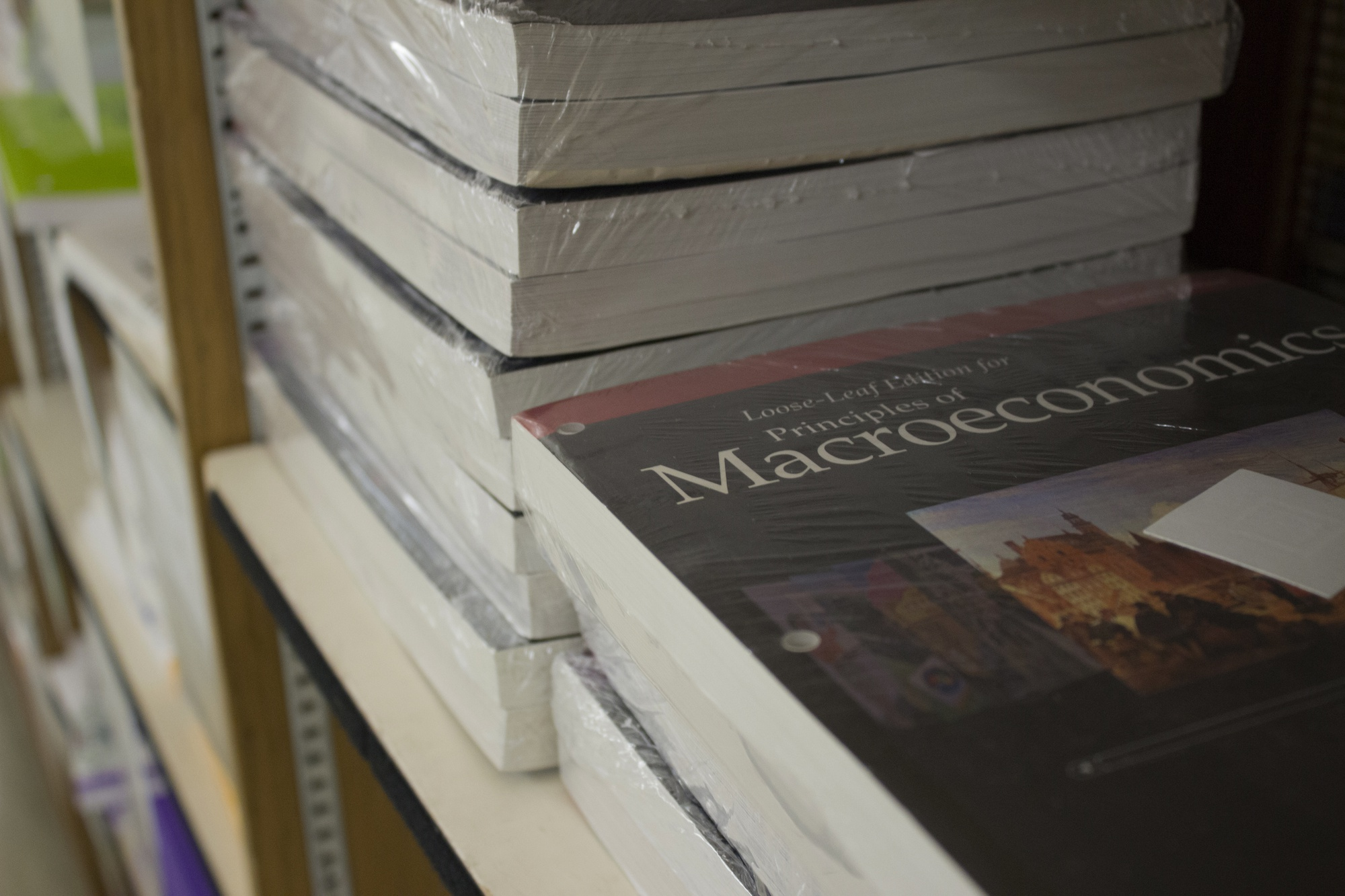 Students enrolled in Harvard's introductory economics course must now purchase loose-leaf copies of N. Gregory Mankiw's Principles of Microeconomics as well as a code to online materials. The course continues to face criticism for being too costly as a required and introductory course for Economics concentrators.