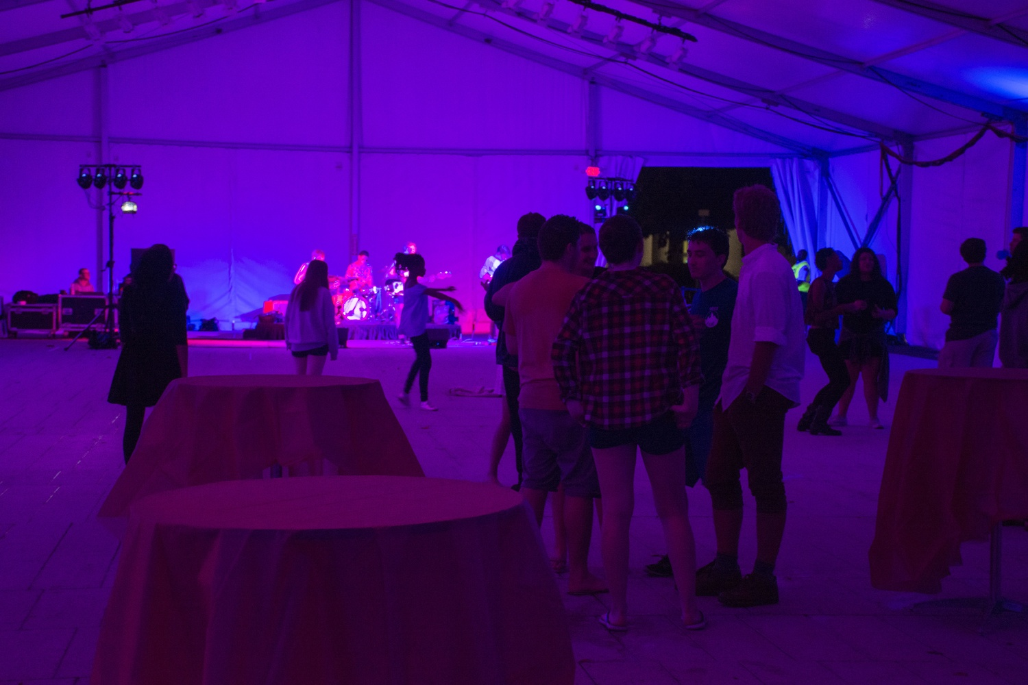 Undergraduates attend the [BLANK] Party under the Science Center Tent Friday evening. [BLANK] Party was hosted by women's groups at Harvard, with a focus on inclusion of students of all identities.