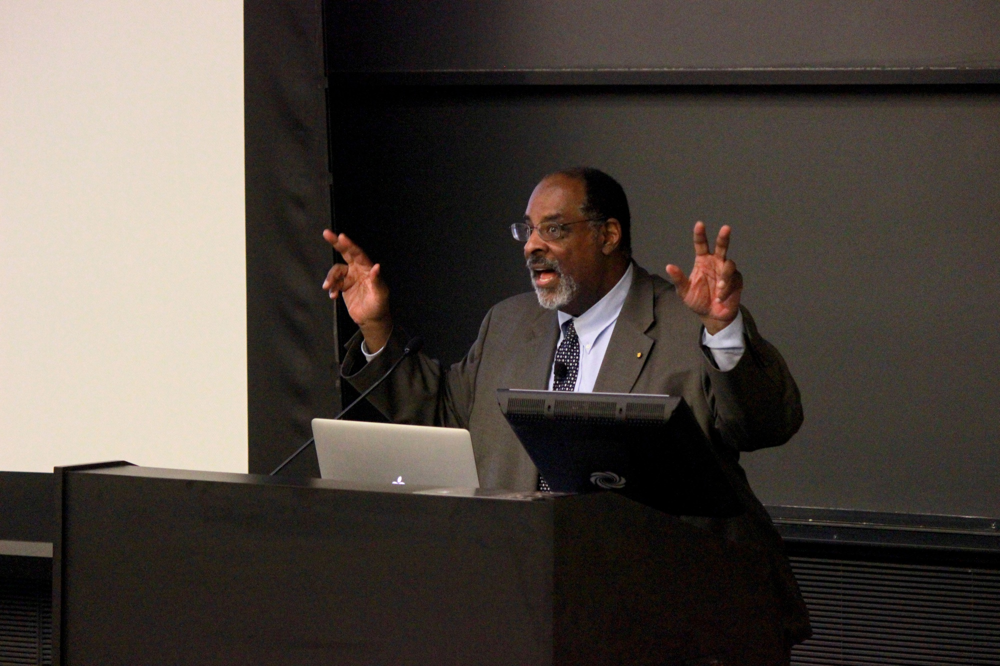 Joseph L. Graves discusses the legacies of former Harvard professor Louis Agassiz and Charles Darwin's legacies in Northwest Labs Tuesday night. The talk was part of a speaker series put on by the Peabody Museum for their 150th anniversary.