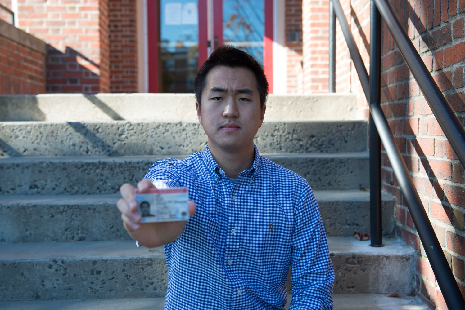 Jin K. Park '18, holding his DACA card, learned English when he moved to the United States when he was 7 years old.