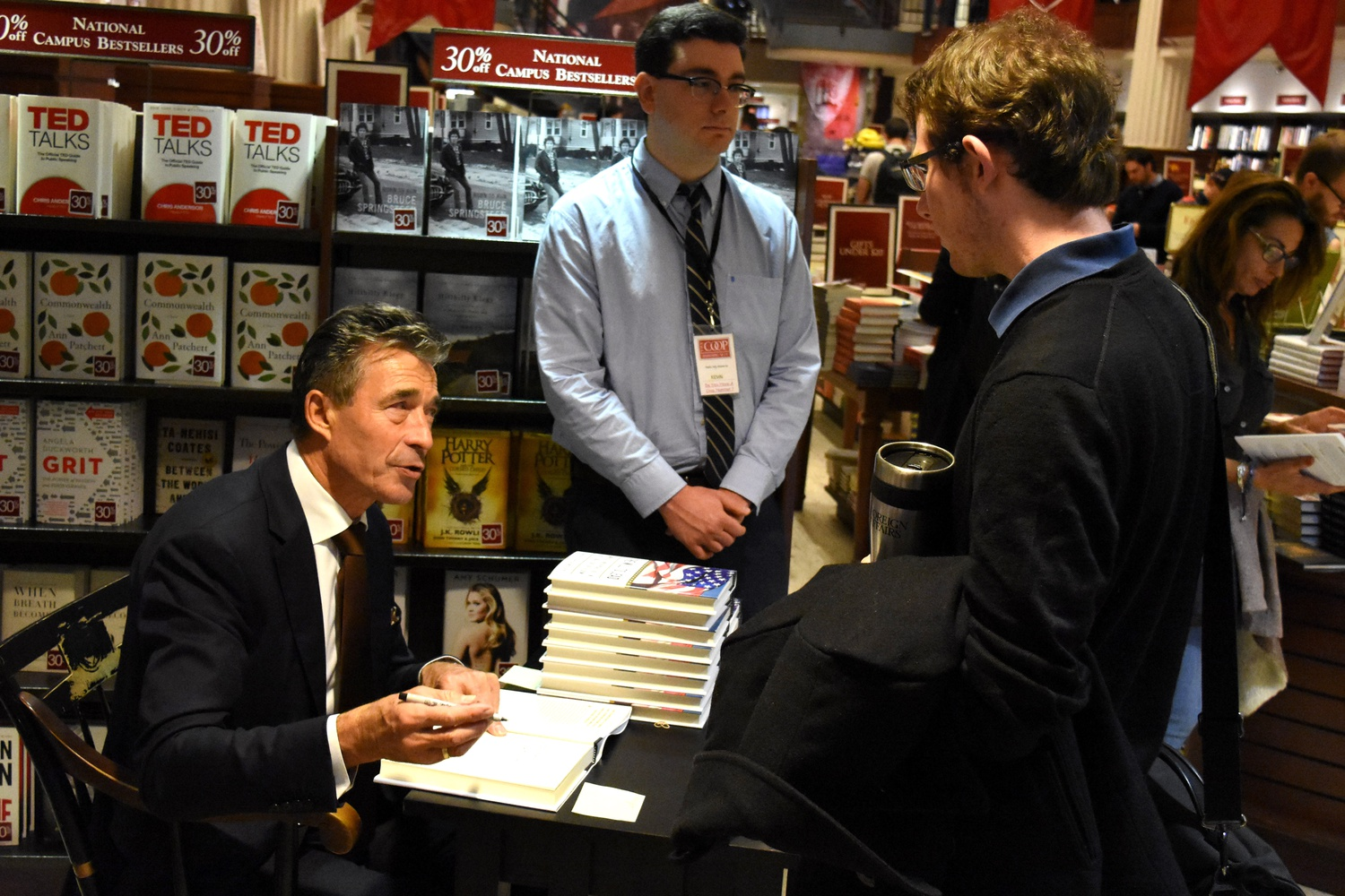 """Former Secretary-General of NATO and former Prime Minister of Denmark Anders Fogh Rasmussen signs his new book at the COOP Monday afternoon. His book, entitled """"The Will To Lead,"""" calls for American leadership in international affairs."""