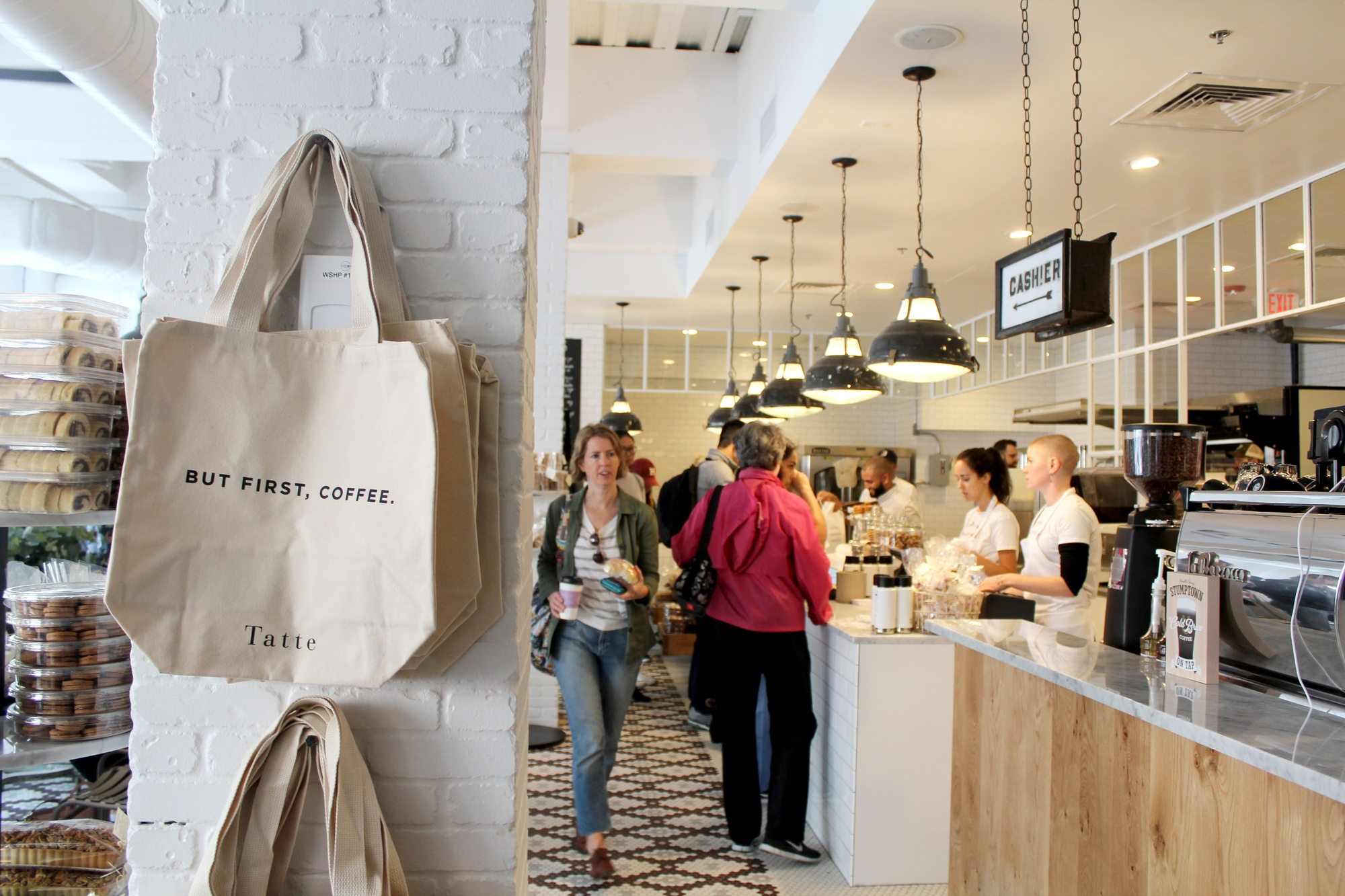 Boston-based bakery Tatte opened its doors in Harvard Square for the first time Tuesday, attracting students and locals for baked goods, coffee, and sandwiches.