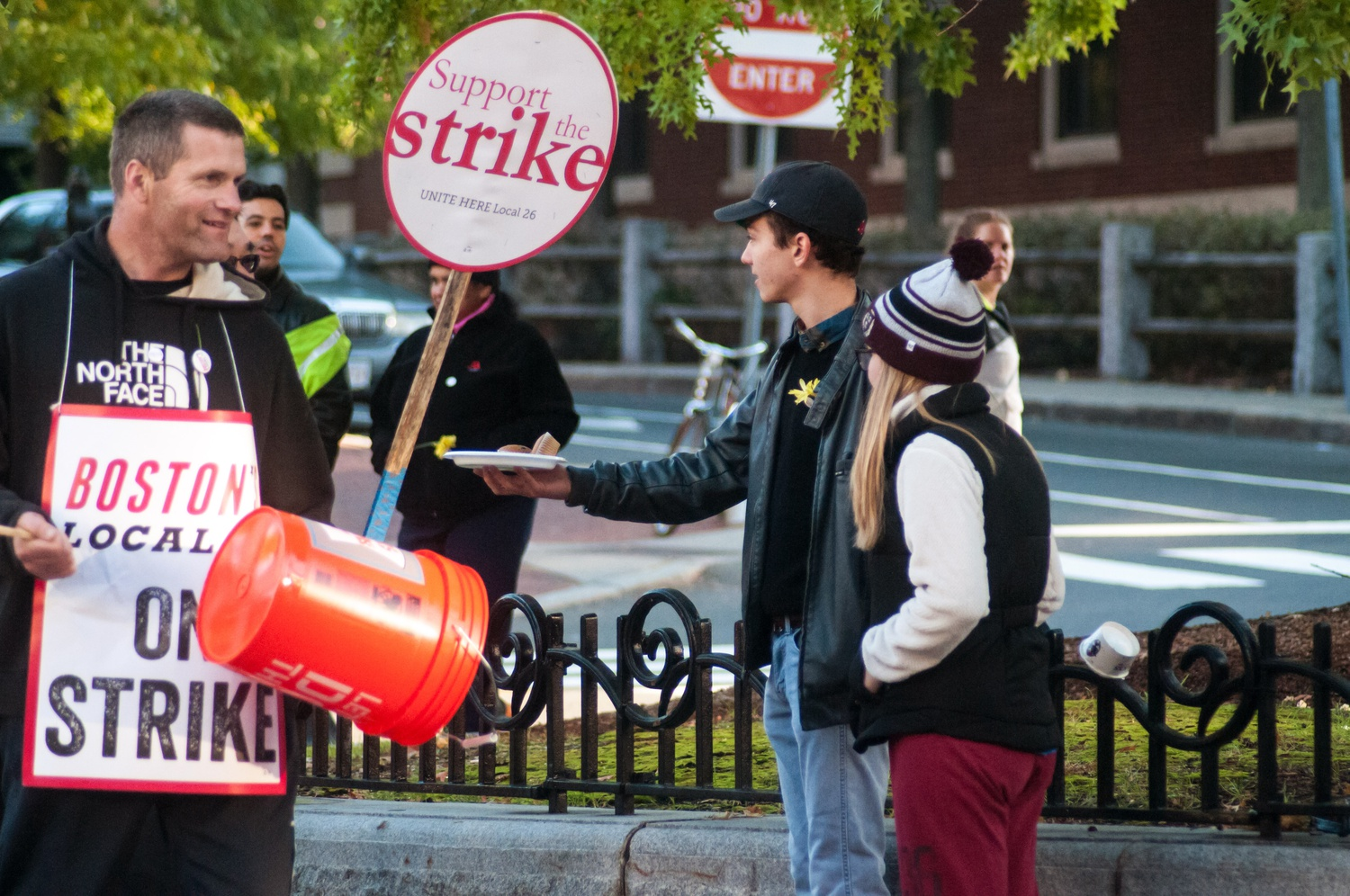 Gabe Hodgkin '18 and Farris Peale '18 deliver breakfast muffins from Quincy dining hall to Harvard University Dining Services workers, who began their strike Wednesday morning.