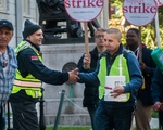 Securitas Officer Extends Handshake to Protestor