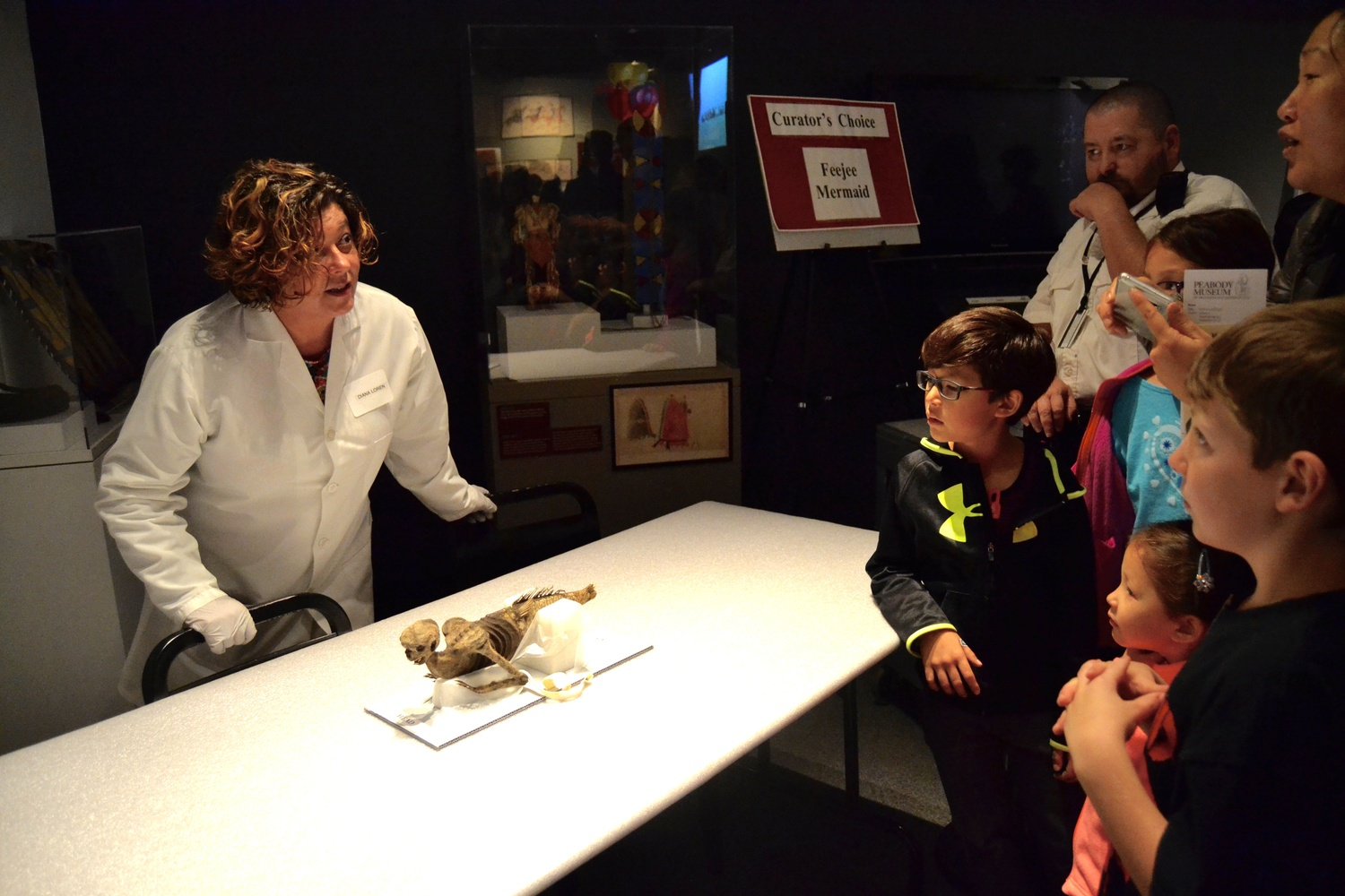 Peabody Director of Academic Partnerships Diana A. Loren shows an audience the Feejee Mermaid. The Peabody Museum of Archaeology and Ethnology celebrated its 150th anniversary on Friday.