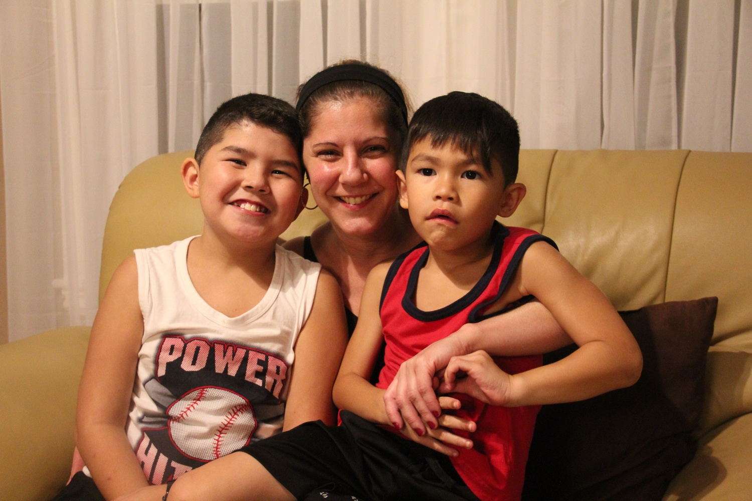 "Jackie lives in Everett, Mass., with her sons Jordan, 11, and Jathan, 6, as well as with her divorced husband (not pictured). Working at Harvard  for her is ""like a second home, away from our home."" To her, Harvard ""feels like a family."""