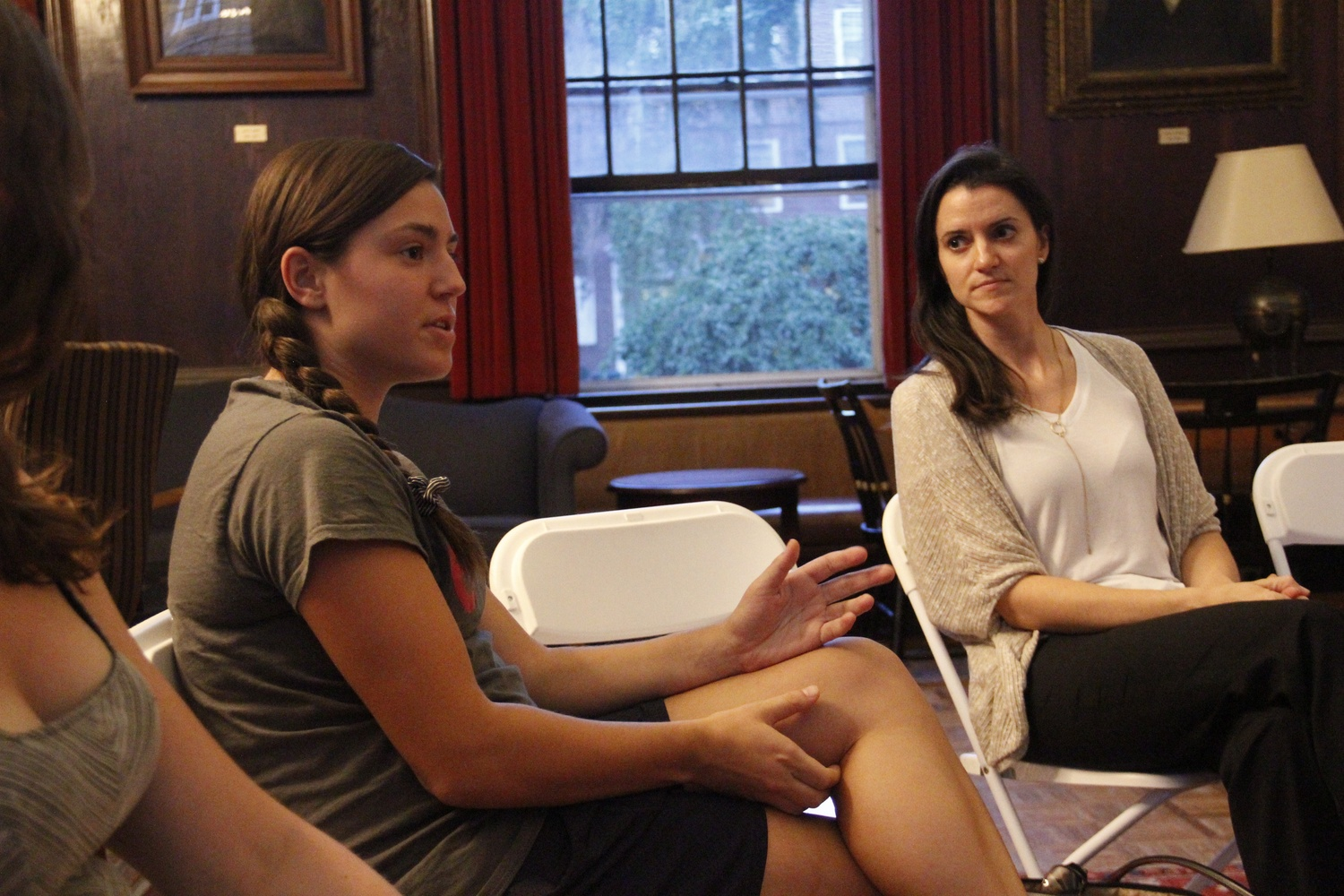 The Student Labor Action Movement hosted a teach-in in Kirkland House on September 21. Lawyer Erin Walczewski (right) began the discussion with background information on labor strikes. Here, a Harvard student poses a question to the group.
