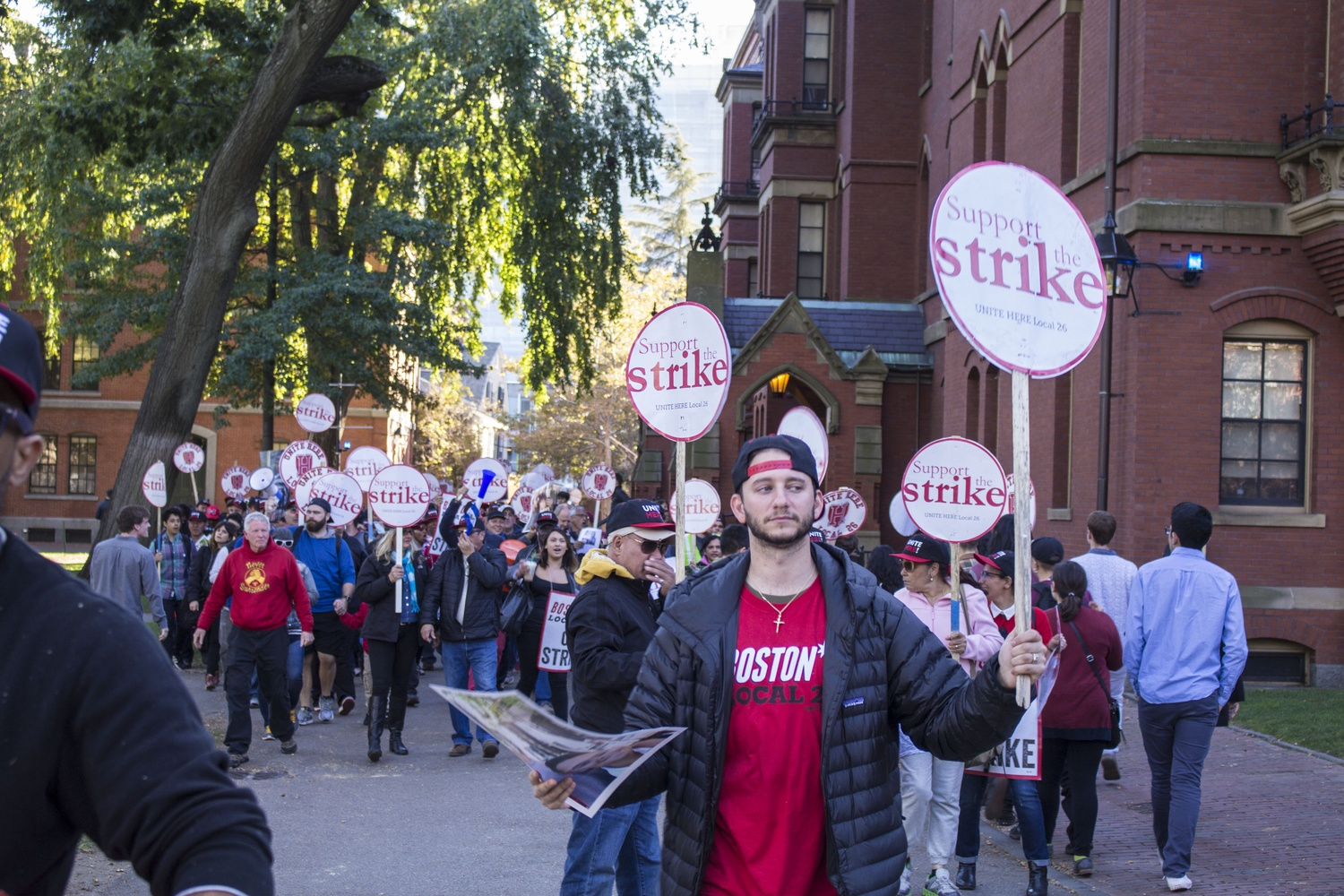 HUDS workers, members of UNITE HERE Local 26, and other HUDS supporters rally in Harvard Yard on Friday afternoon.