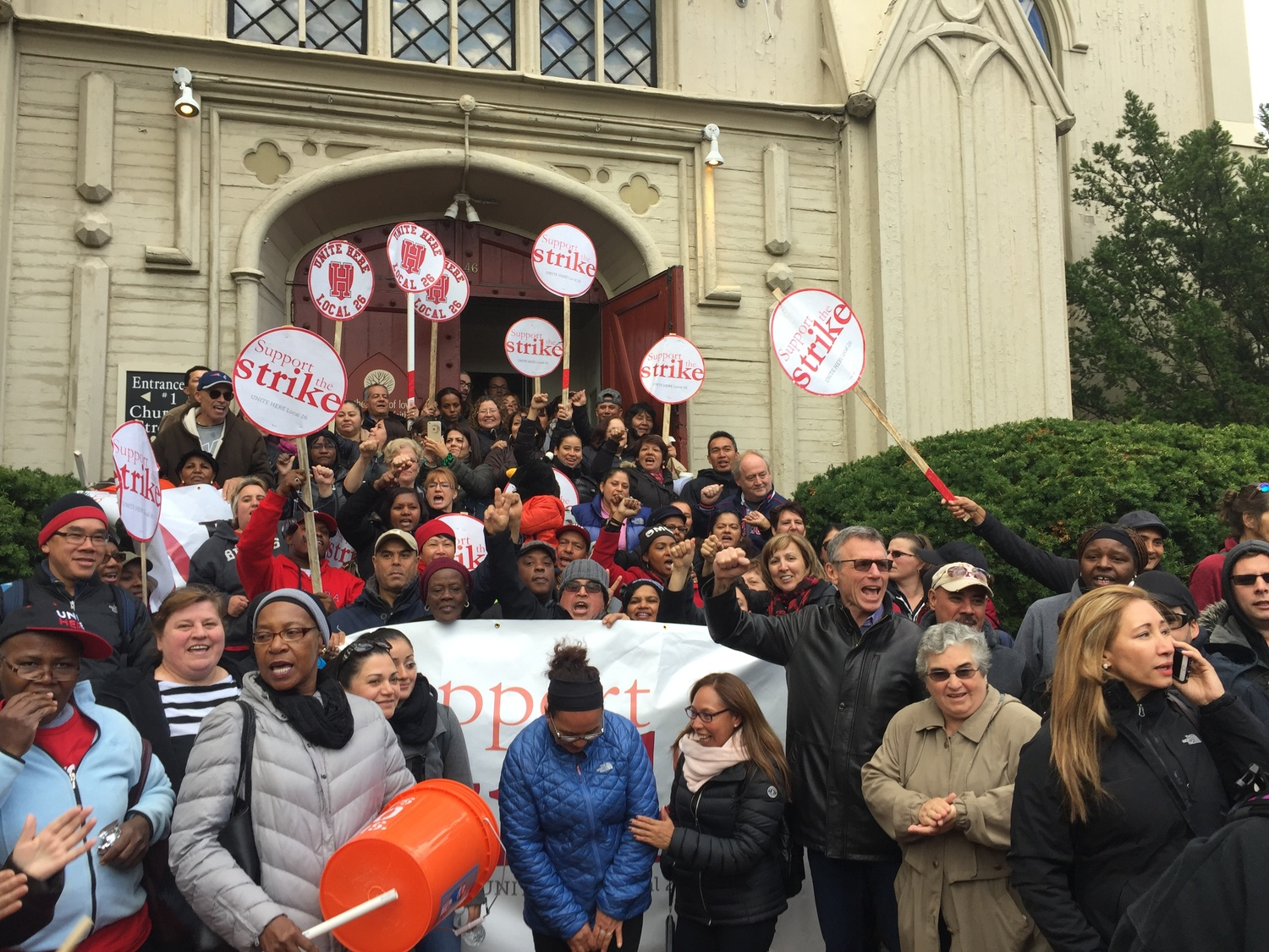 HUDS employees and union members gather at the contract announcement at First Parish Church Wednesday afternoon.