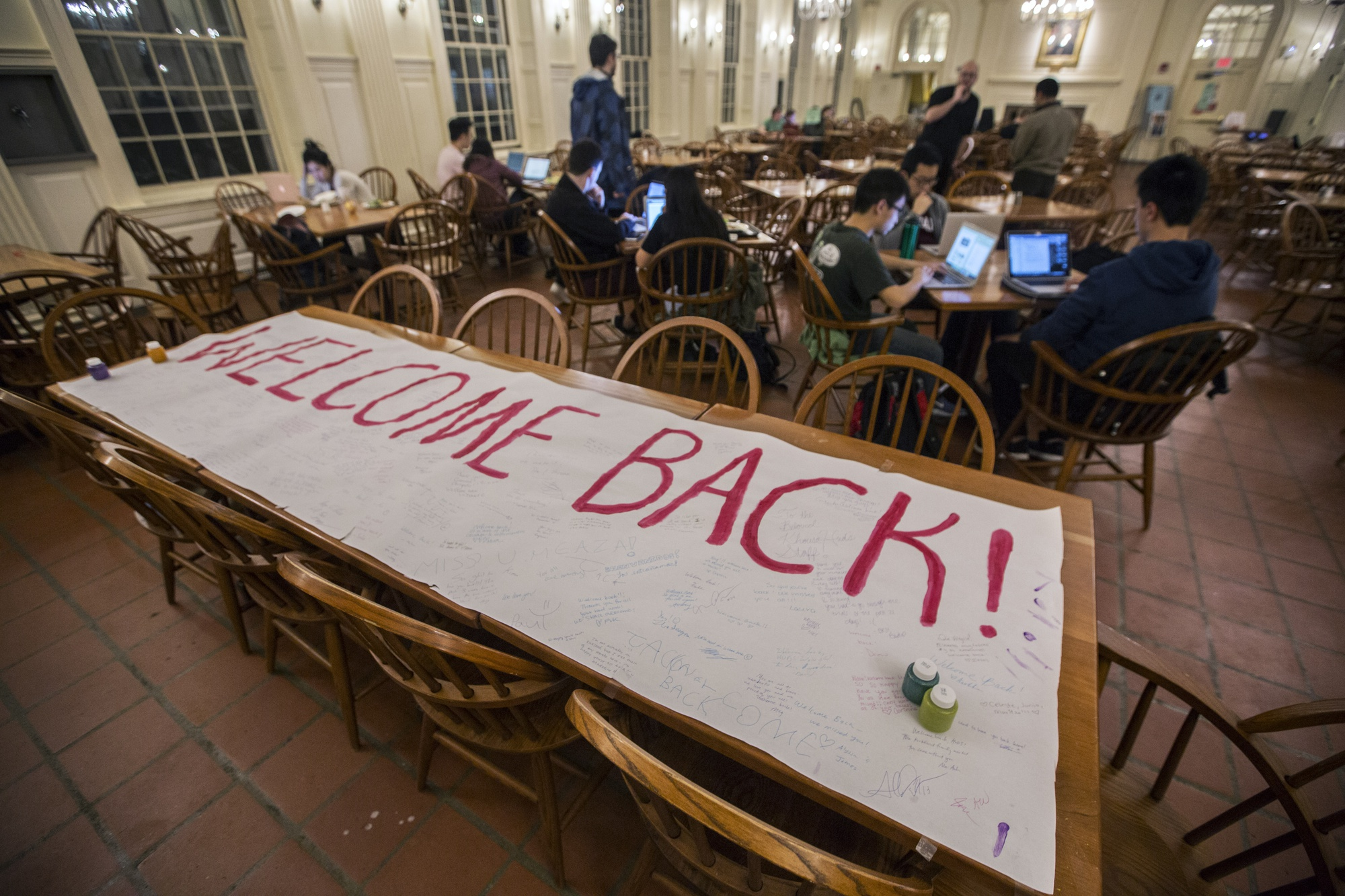 """""""Welcome back! So in awe of your courage and determination,"""" wrote one student on a welcome banner in Kirkland dining hall. Students celebrated HUDS workers returning to the dining halls after the 22-day long strike which ended Wednesday."""