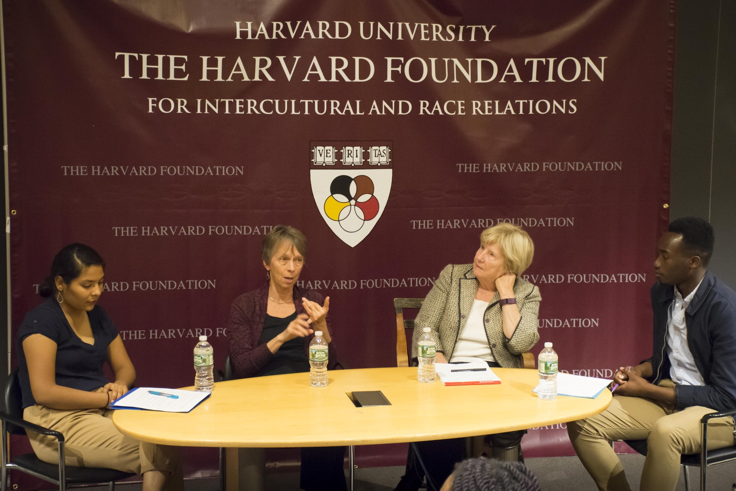 Graduate School of Education Professors Susan Moore Johnson and Katherine K. Merseth discuss Massachusetts' charter school ballot measure as Harvard Foundation members Nuha Saho '18 and Brenda Esqueda '20 look on. The panel discussion on equity and access in education was hosted by the Harvard Foundation Tuesday night.