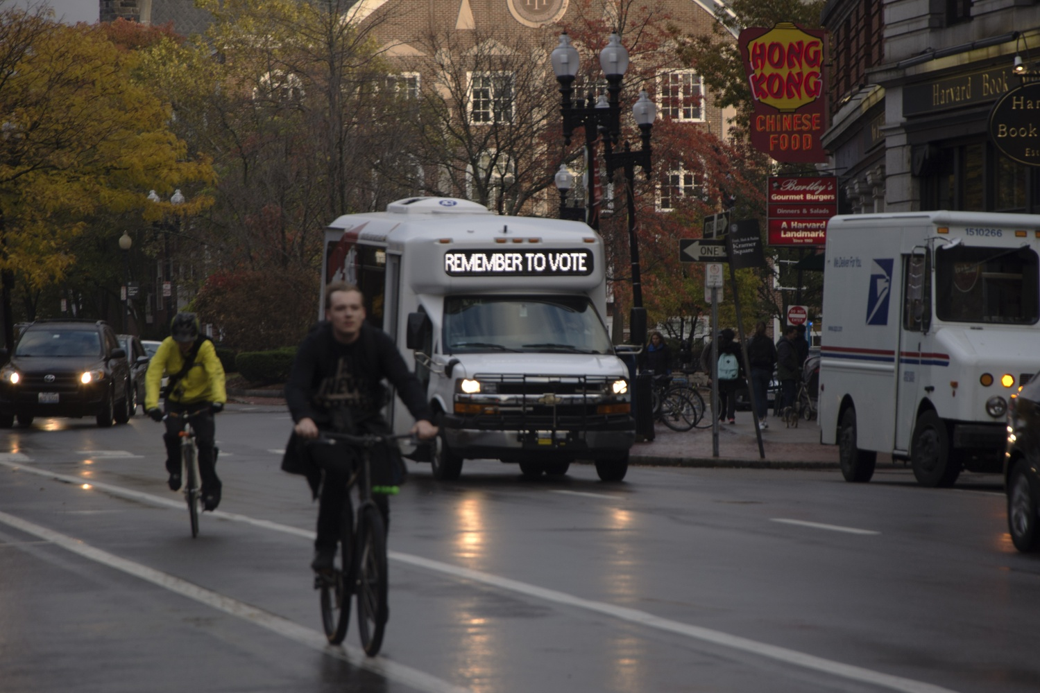 """A Daytime Van Service vehicle displays a """"Remember to Vote"""" message. In the run up to the Presidential Elections, Harvard Shuttles have been seen around campus alternating between their destinations and a reminder to vote."""