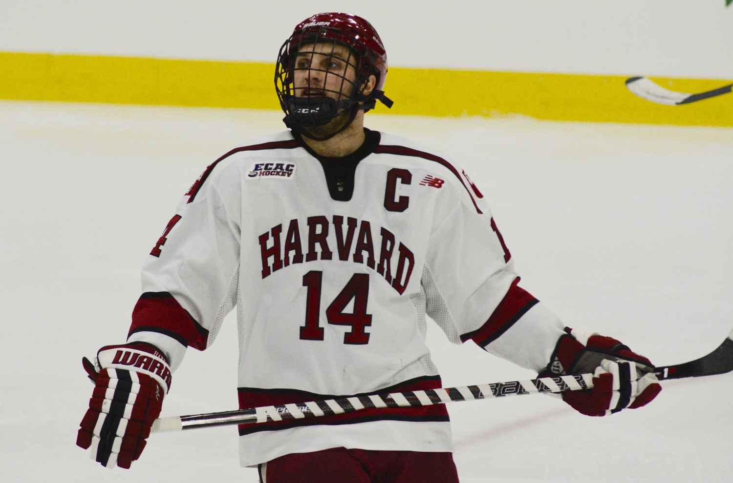 Co-captain Alexander Kerfoot's first goal of the season with 7:08 remaining in Friday night's ECAC opener earned Harvard a point out of what was an otherwise frustrating contest for the Crimson.