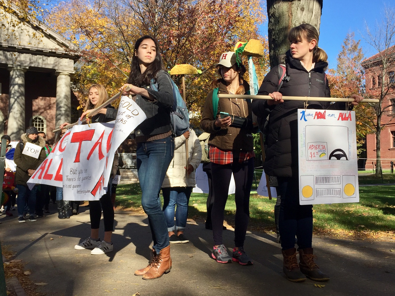 Students in Spanish 126: Performing Latinidad process through the yard costumed as a taco truck as a part of a performance piece exploring latinx experiences in the United States. The procession made stops around Harvard Yard for a poetry reading, a coordinated spoken word piece, and other acted performances commenting on anti-latinx discourse in the 2016 presidential election.