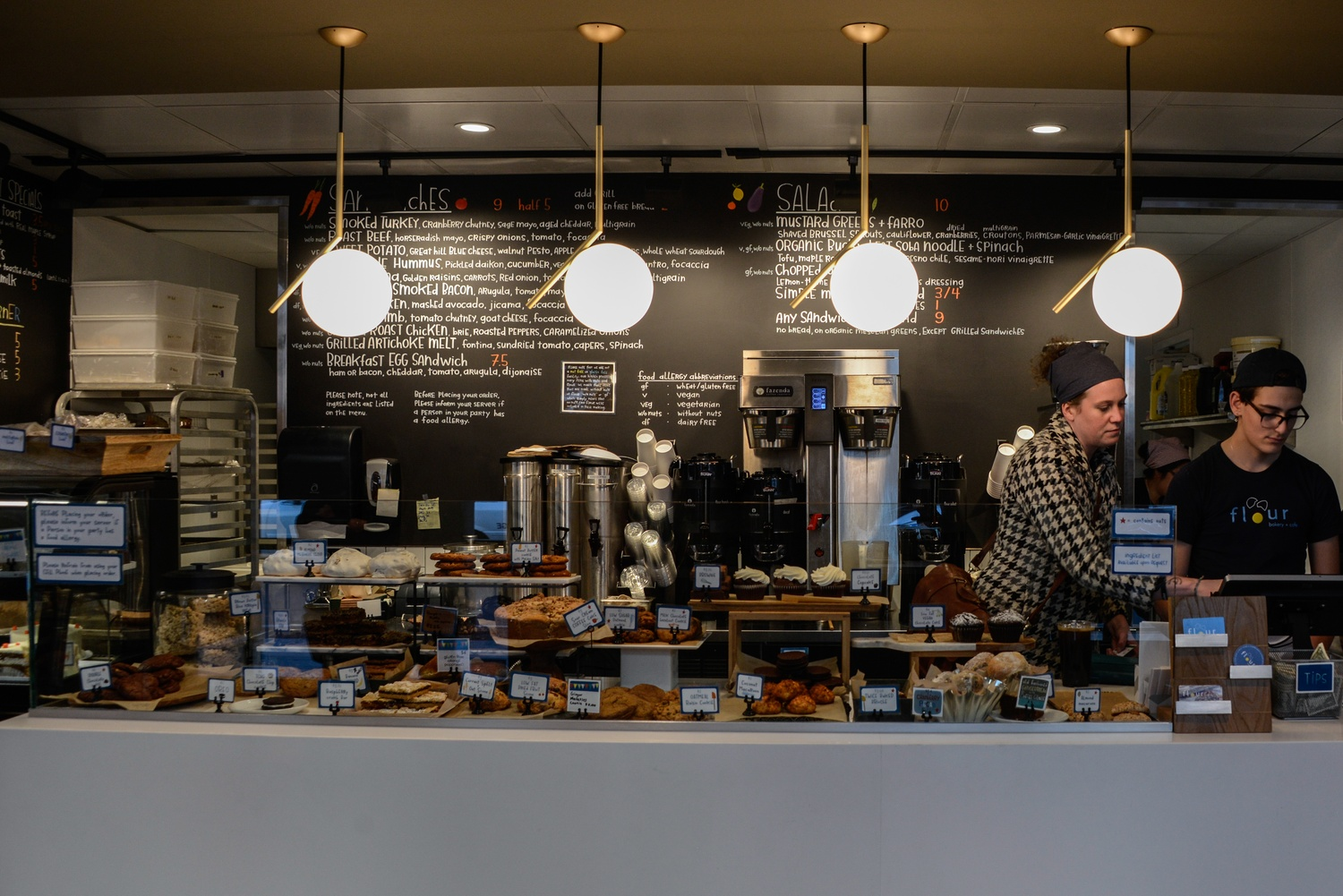 Two salespeople work at Flour, Harvard Square's new cafe-bakery.