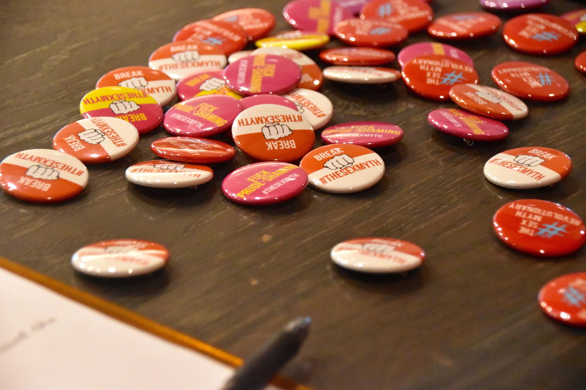 """Pins decorated with the message """"Break #TheSexMyth"""" on display at """"Busting Sexual Stereotypes"""" on Friday in Sever Hall. The event was held as part of the annual Harvard Sex Week. """