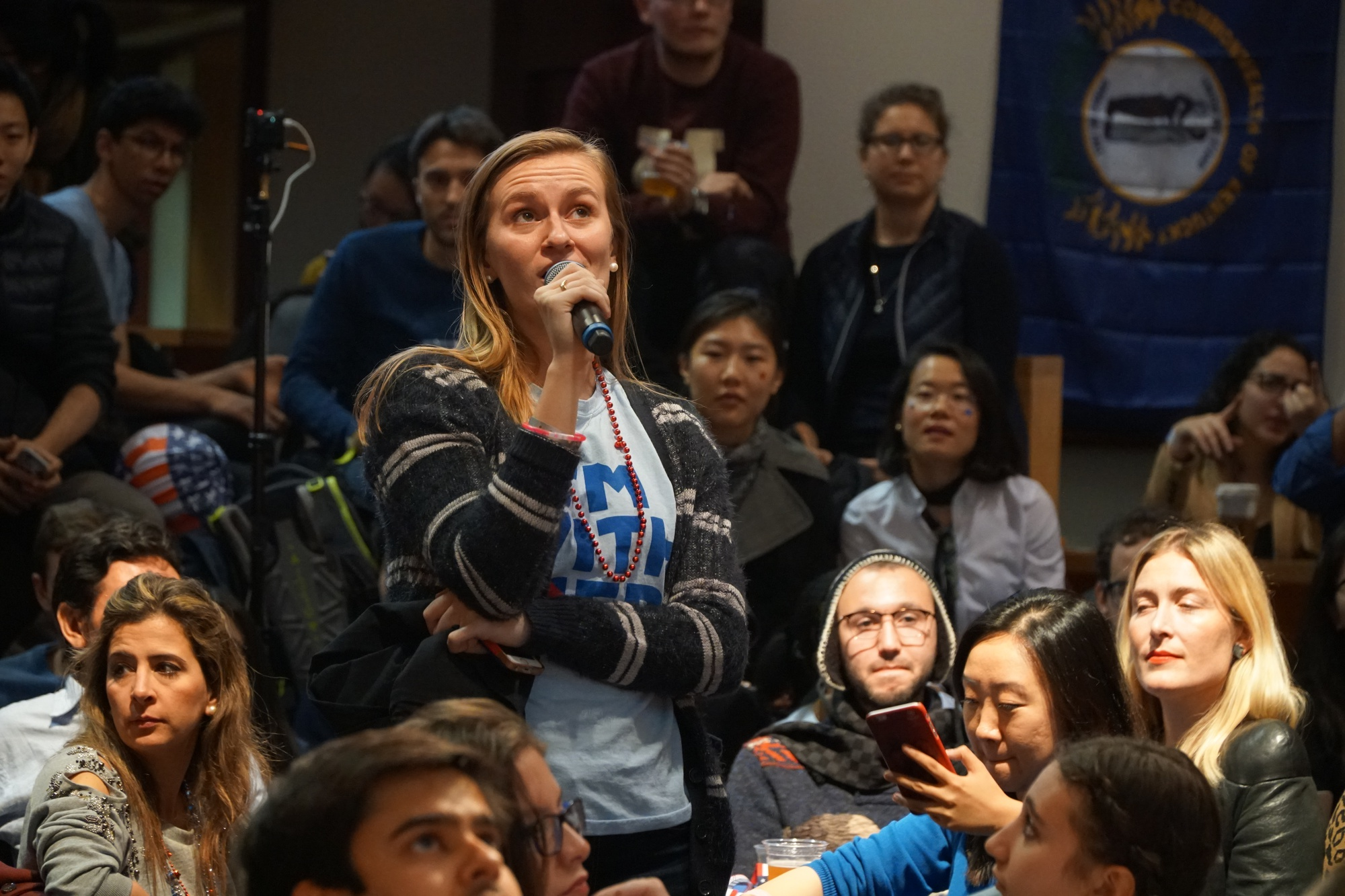 Caroline M. Tervo '18 asks a question at the IOP election night watch party on Tuesday. The celebration ended at midnight without the planned balloon drop and declaration of victory expected by students and other attendees.