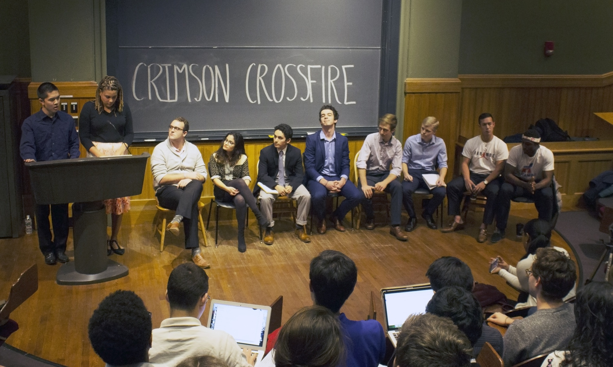 """Students running for the Undergraduate Council president and vice president positions participate in a debate hosted by The Harvard Crimson reporters on Friday night. The debate, called """"Crimson Crossfire,"""" covered topics such as sexual assault prevention and social club policies."""