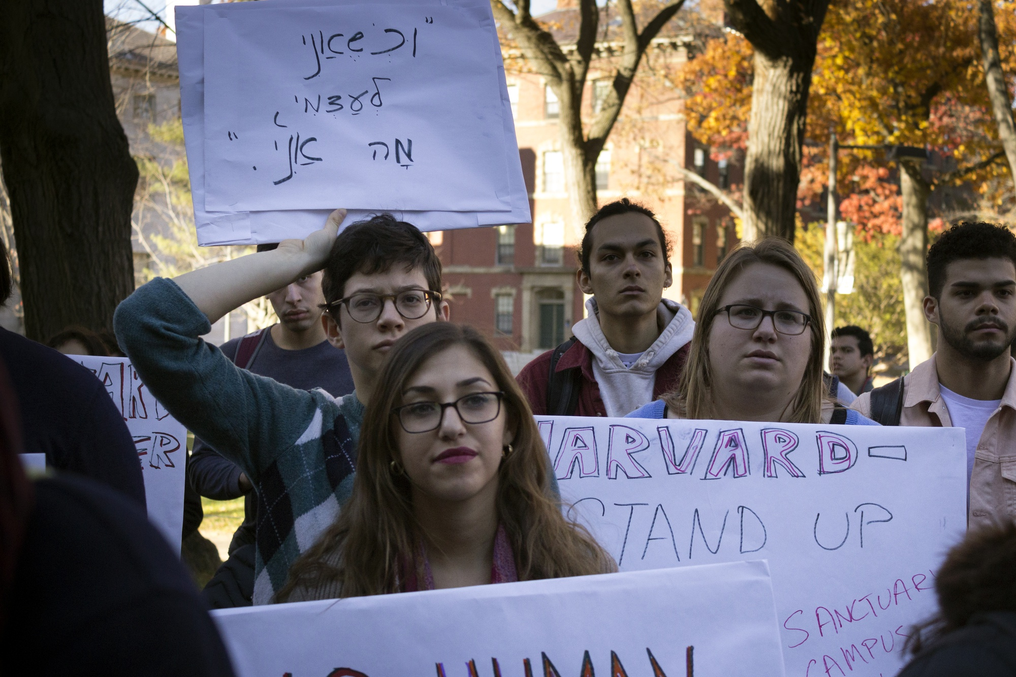 More than 100 supporters gather on the steps of Widener Library to advocate for the defense of undocumented students at Harvard.