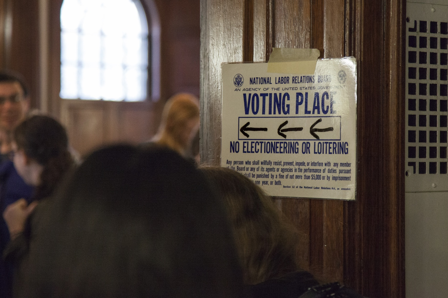 A sign directs voters to the polling place for the Harvard Graduate Students Union-United Automobile Workers first unionization vote in 2016. After a second vote in 2018, the National Labor Relations Board certified the results of the election, which created the first student union in Harvard's history.