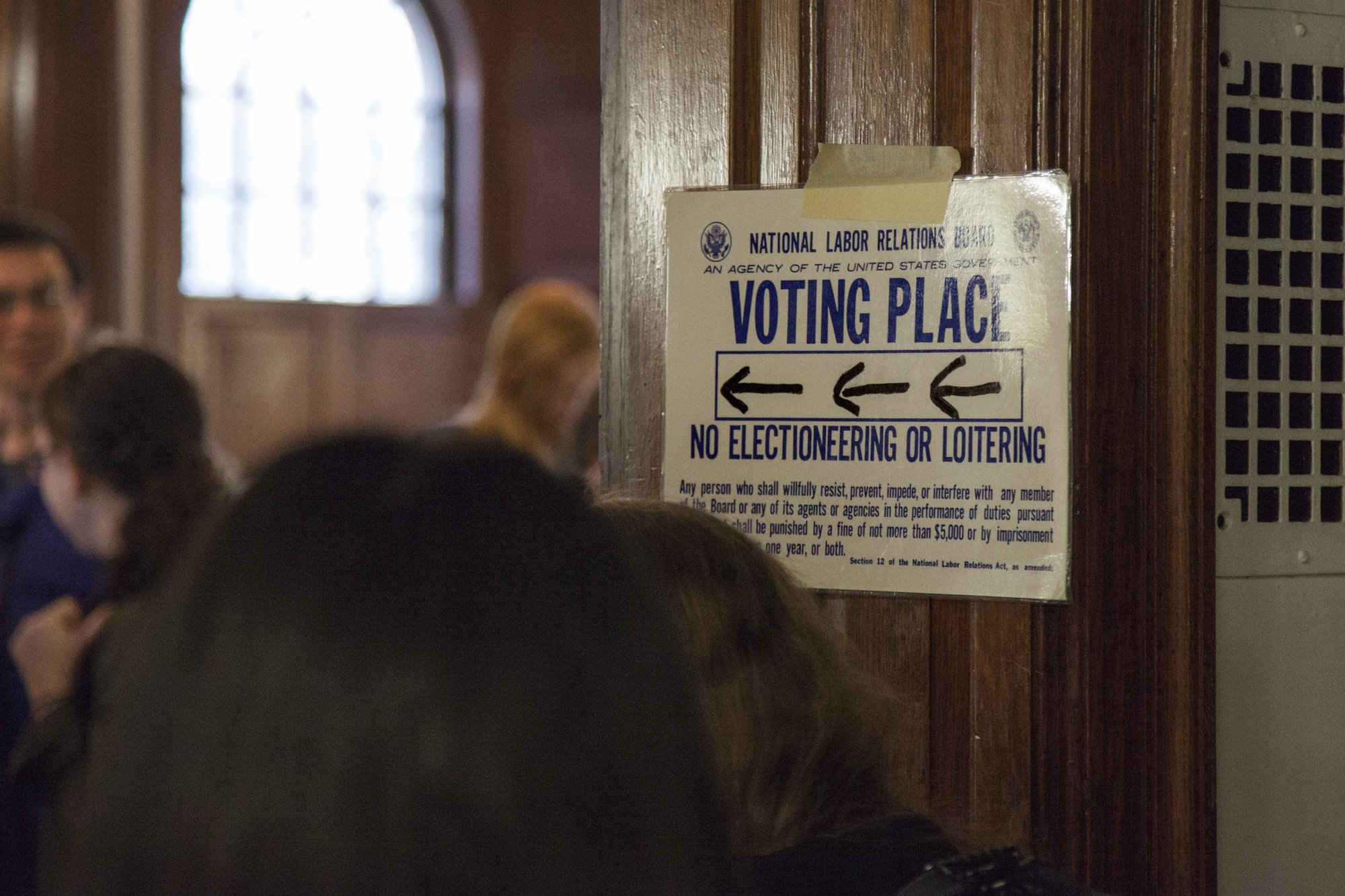 A posted sign directs voters to the polling place for the Harvard Graduate Students Union-UAW unionization vote in Phillips Brooks House Wednesday afternoon. Eligible graduate and undergraduate students are voting to decide whether they will be represented by the HGSU-UAW union.