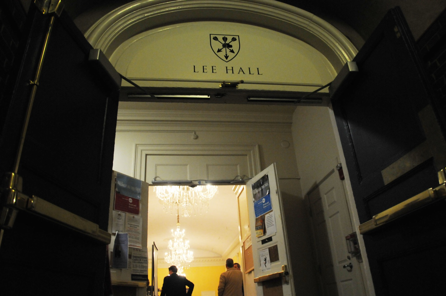 """A sign above the entrance to Lowell House dining hall indicates the new name of """"Lee Hall."""" The dining hall was renamed after a donation from Kewsong Lee '86."""