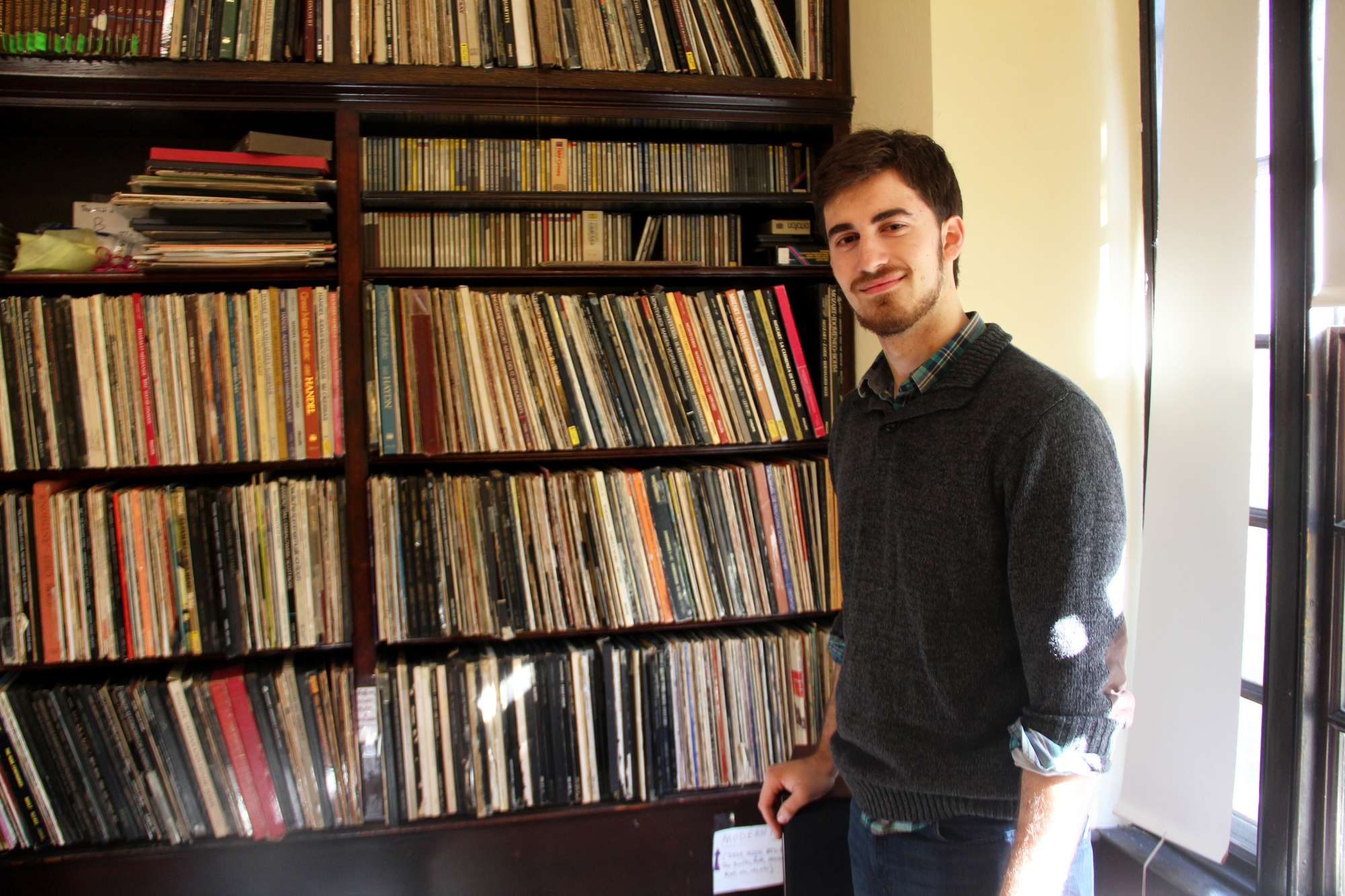 A resident of Eliot House and the house's official librarian, Tim runs the record room, the recording studio, and the Eliot bike-sharing program. Here, he stands in the record room after putting on Chopin's Nocturne No. 1.