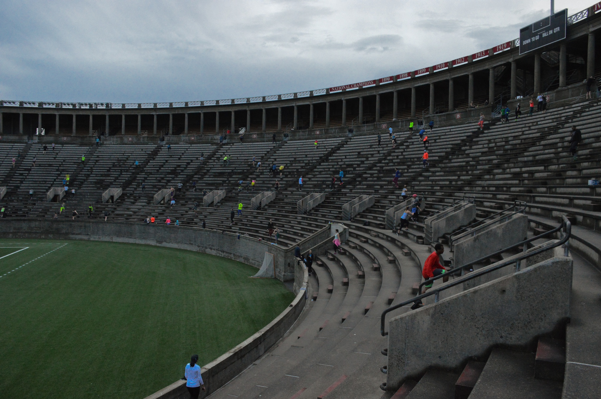 On Wednesday mornings, figures in brightly-colored athletic gear can be seen trekking up and down the steps of Harvard Stadium.  Participants in the November Project aim to traverse the stadium by climbing the steps of each of its thirty-seven sections in turn.