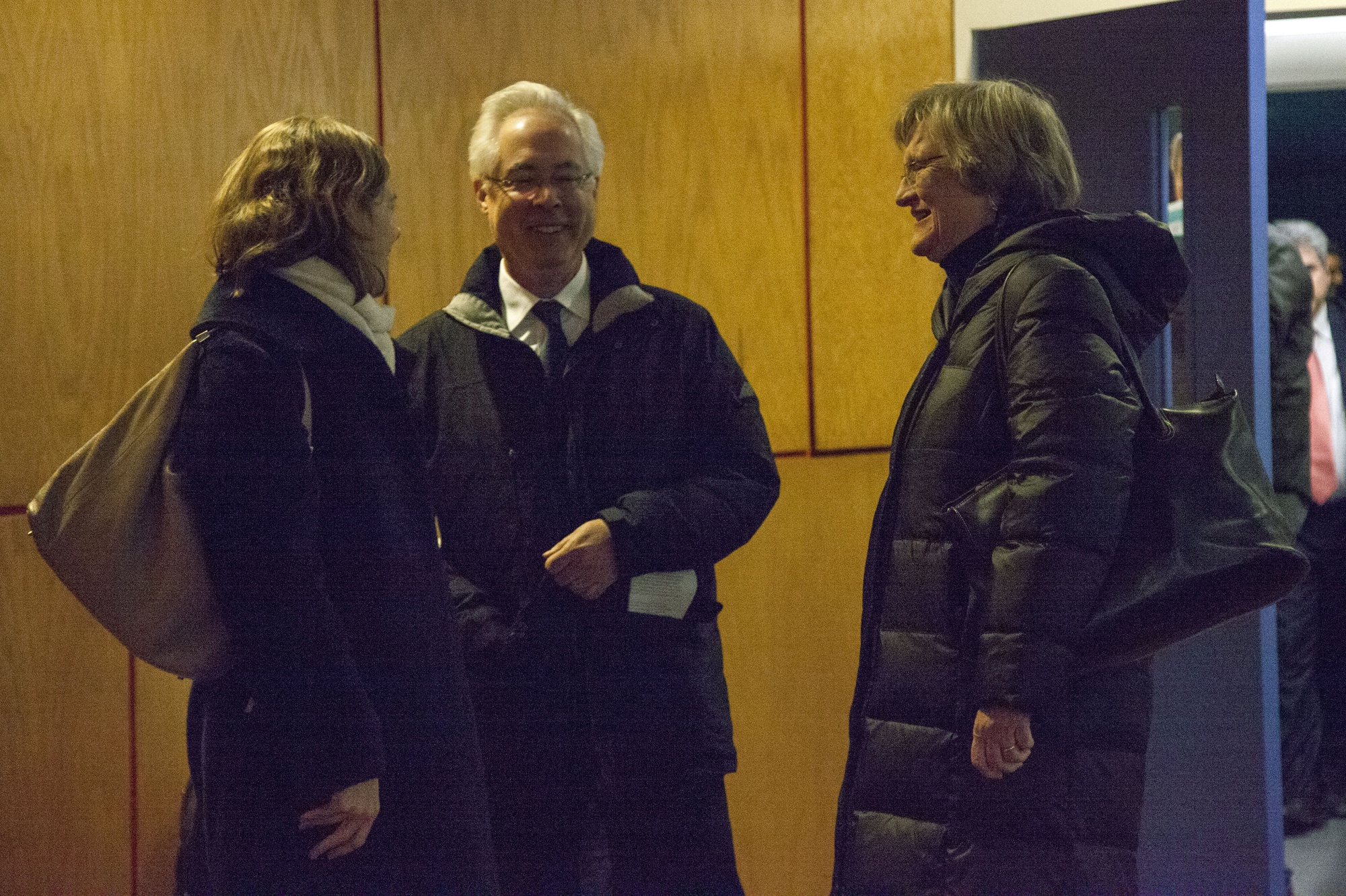 Philosophy professor Alison Simmons, English professor Louis Menand and University President Drew G. Faust talk after the Faculty meeting on Tuesday.