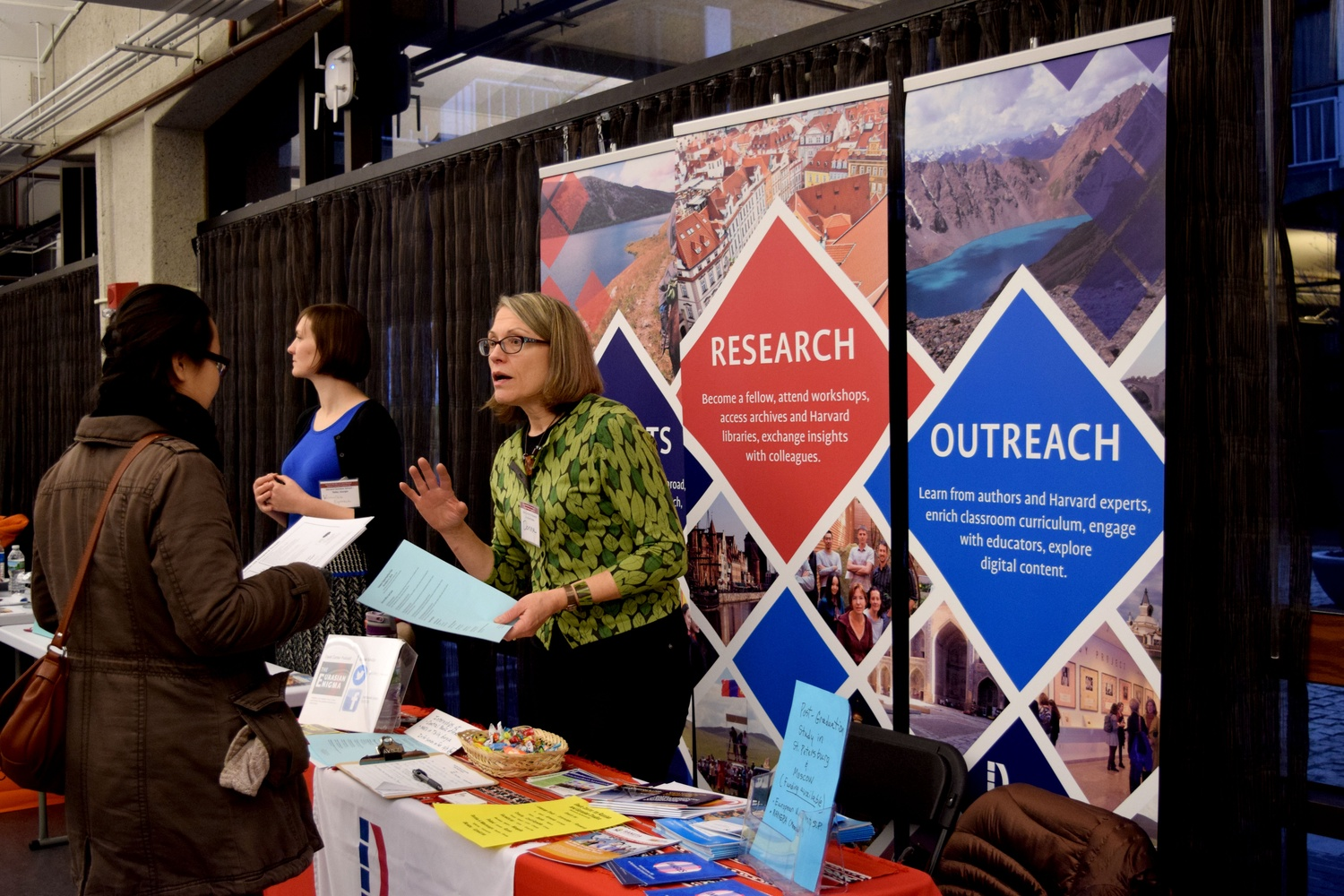 A recruiter from the Davis Center for Russian and Eurasian Studies encourages students to apply for international internships and funding at the Office of Career Services's Summer Funding and Programs Fair Tuesday afternoon in the SOCH.