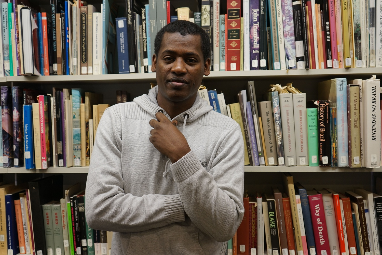 Beekan Erena in the library of The Hutchins Center for African & African American Research, which hosted him as a Scholars at Risk Fellow last year.