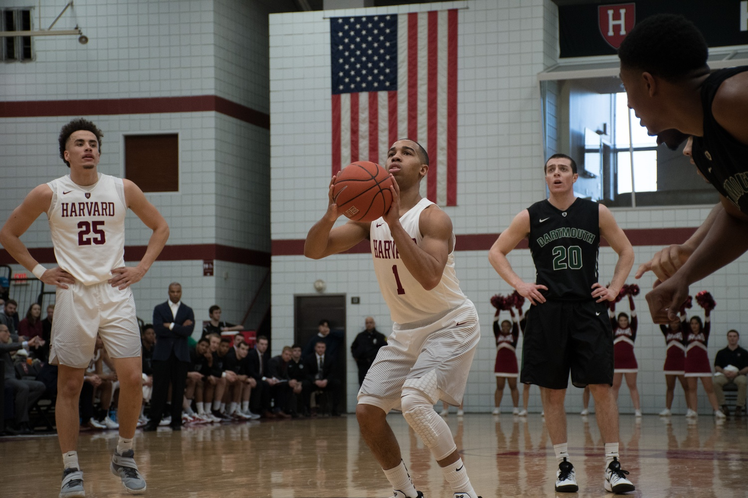 Co-Captain Siyani Chambers prepares for a free throw against Dartmouth on Saturday. Harvard's strong defense led to an 82-68 victory against the Big Green.