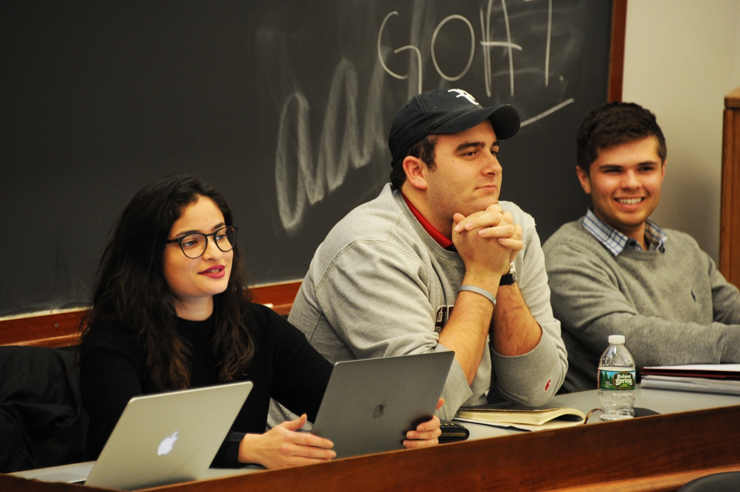 UC President Yasmin Z. Sachee '18 and Vice-President Cameron K. Khansarinia '18 talk at a Undergraduate Council meeting in Harvard Hall on Sunday.