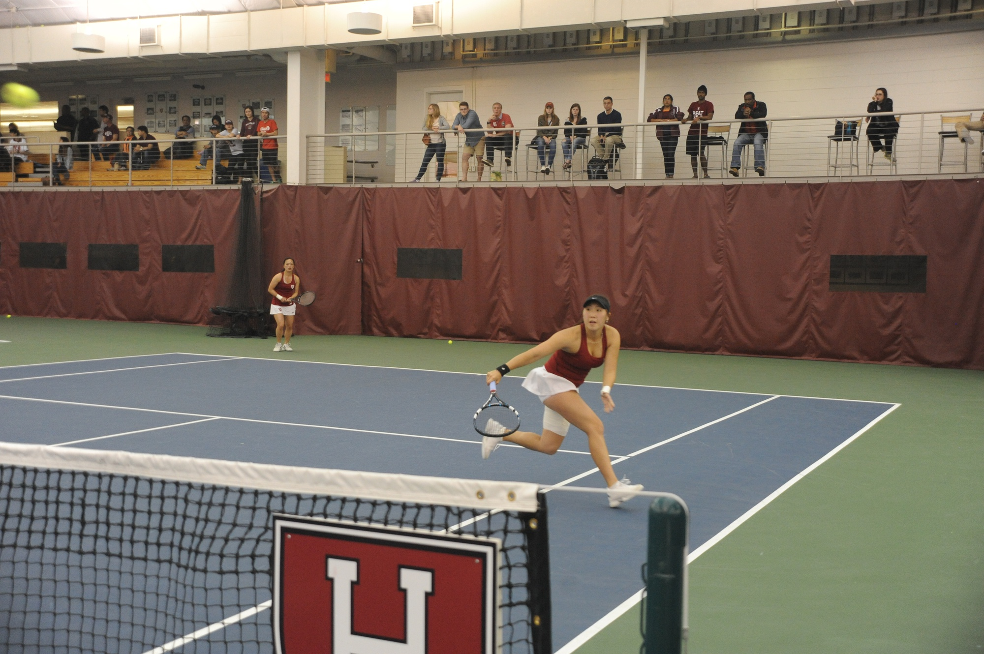 Captain June Lee leads the tennis team to an undefeated weekend against Rhode Island, Georgetown, and Boston College in the team's first home match up of the season.