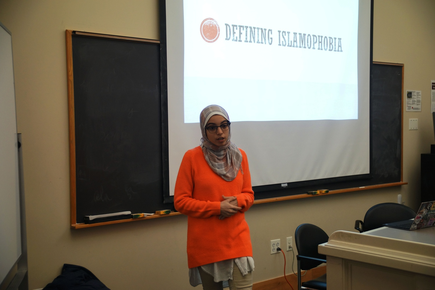 Anwar Omeish '18 gives a talk on Islamophobia as part of the Stand Up With Our Muslim Neighbors event held at Boylston Hall Monday night.