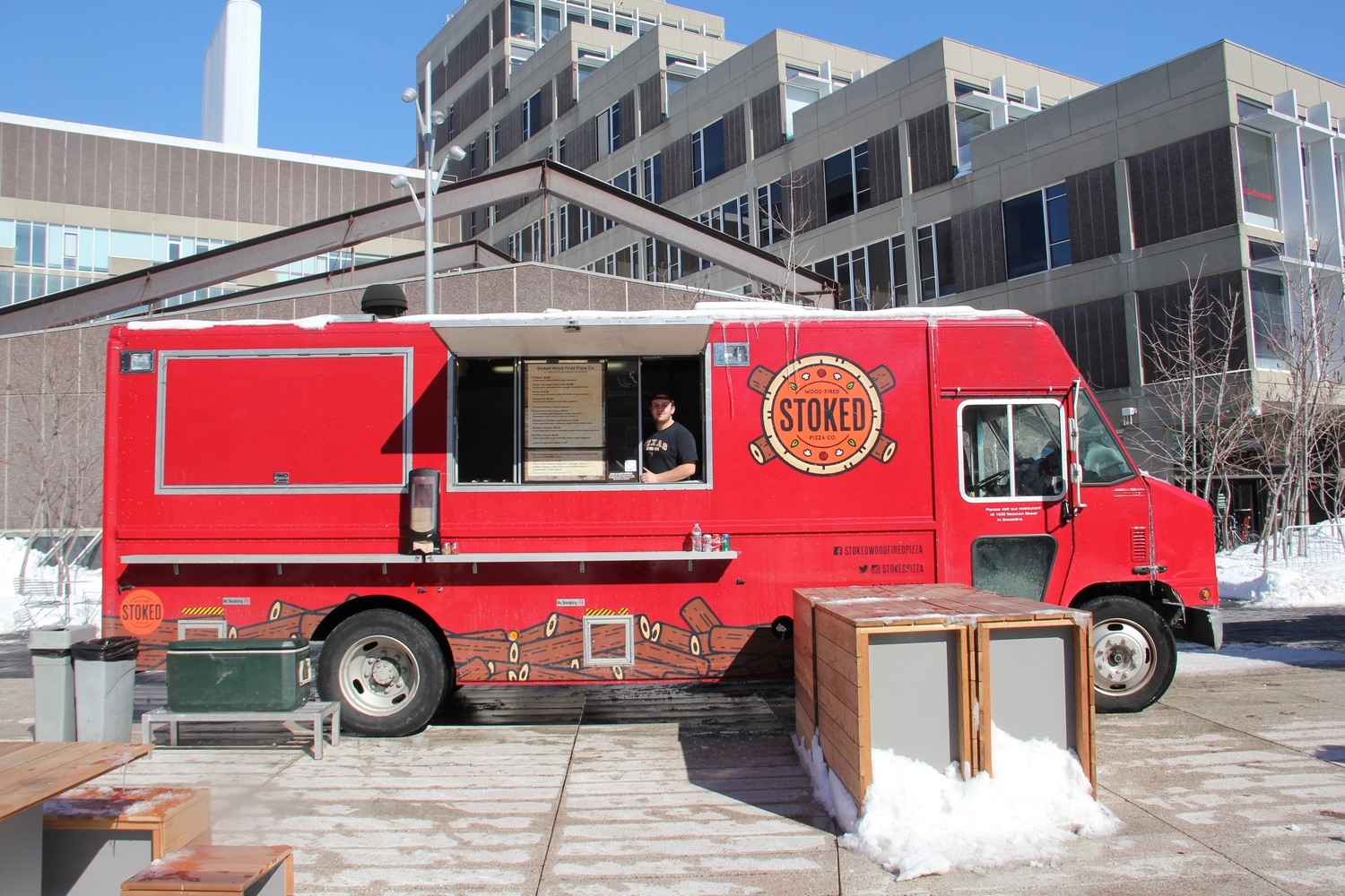 Ryan Mailhot, of Stoked Wood Fire Pizza Co., poses with his truck on Tuesday.