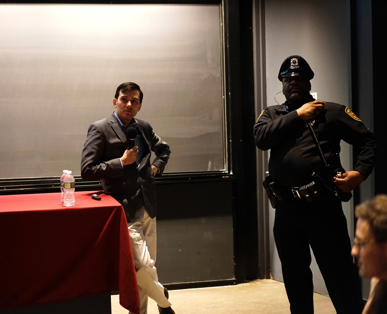 """Martin Shkreli speaks in the Science Center on Wednesday night at an event organized by the Harvard Financial Analysts Club. Protesters disrupted the event, standing up, walking out, and encouraging others to move to a """"teach-in"""" panel on AIDS treatment and unethical pharmaceutical practices."""