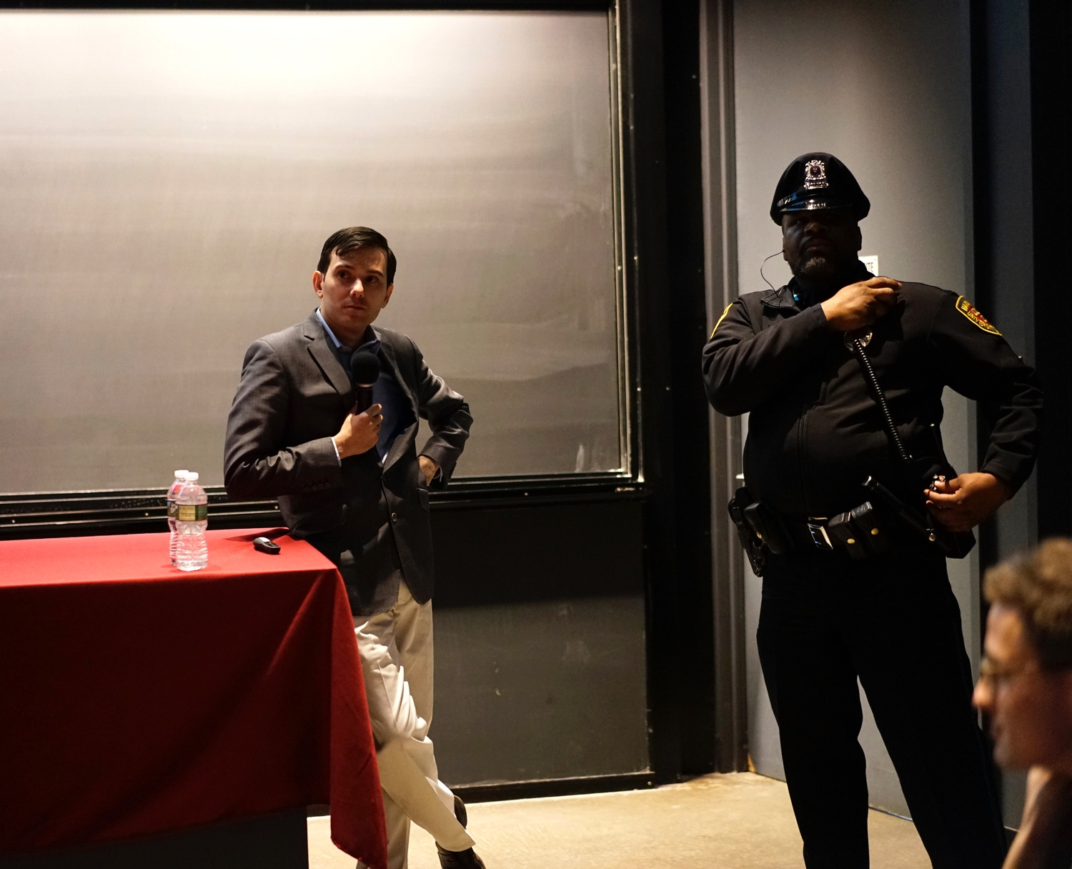"Martin Shkreli speaks in the Science Center on Wednesday night at an event organized by the Harvard Financial Analysts Club. Protesters disrupted the event, standing up, walking out, and encouraging others to move to a ""teach-in"" panel on AIDS treatment and unethical pharmaceutical practices."