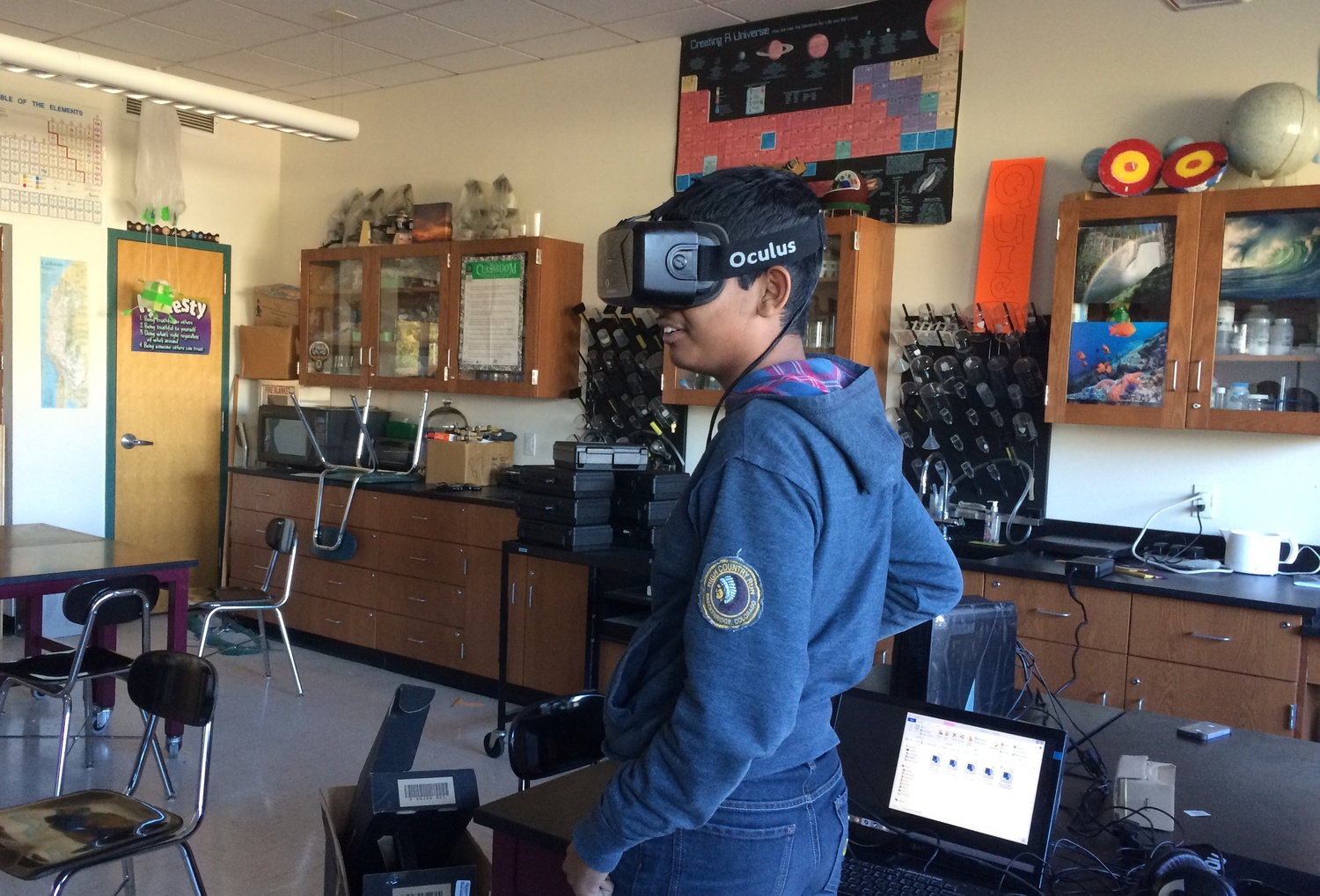 A student tries on a virtual reality headset, as a part of Dreamporte. Dreamporte is a student group at Harvard that aims to bring virtual reality into classrooms at middle schools.