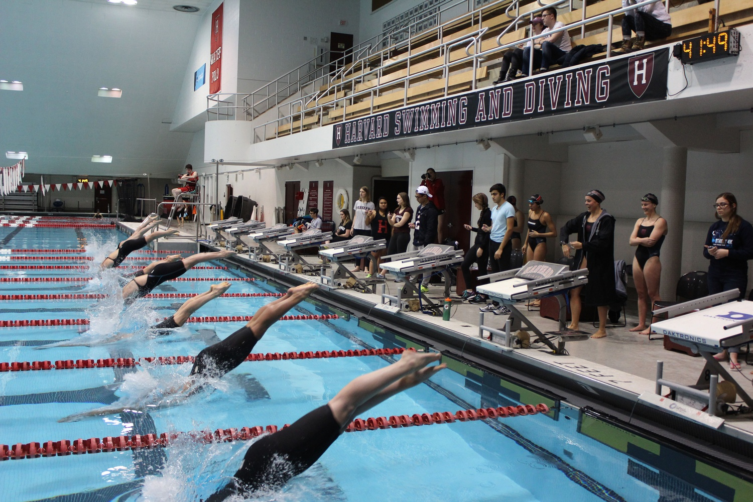 Sophomore Sonia Wang battled back from an injury to win the 400 individual medley at Ivy League Championships and led Harvard women's swimming, pictured here in earlier action against Northeastern, to a second-place finish.